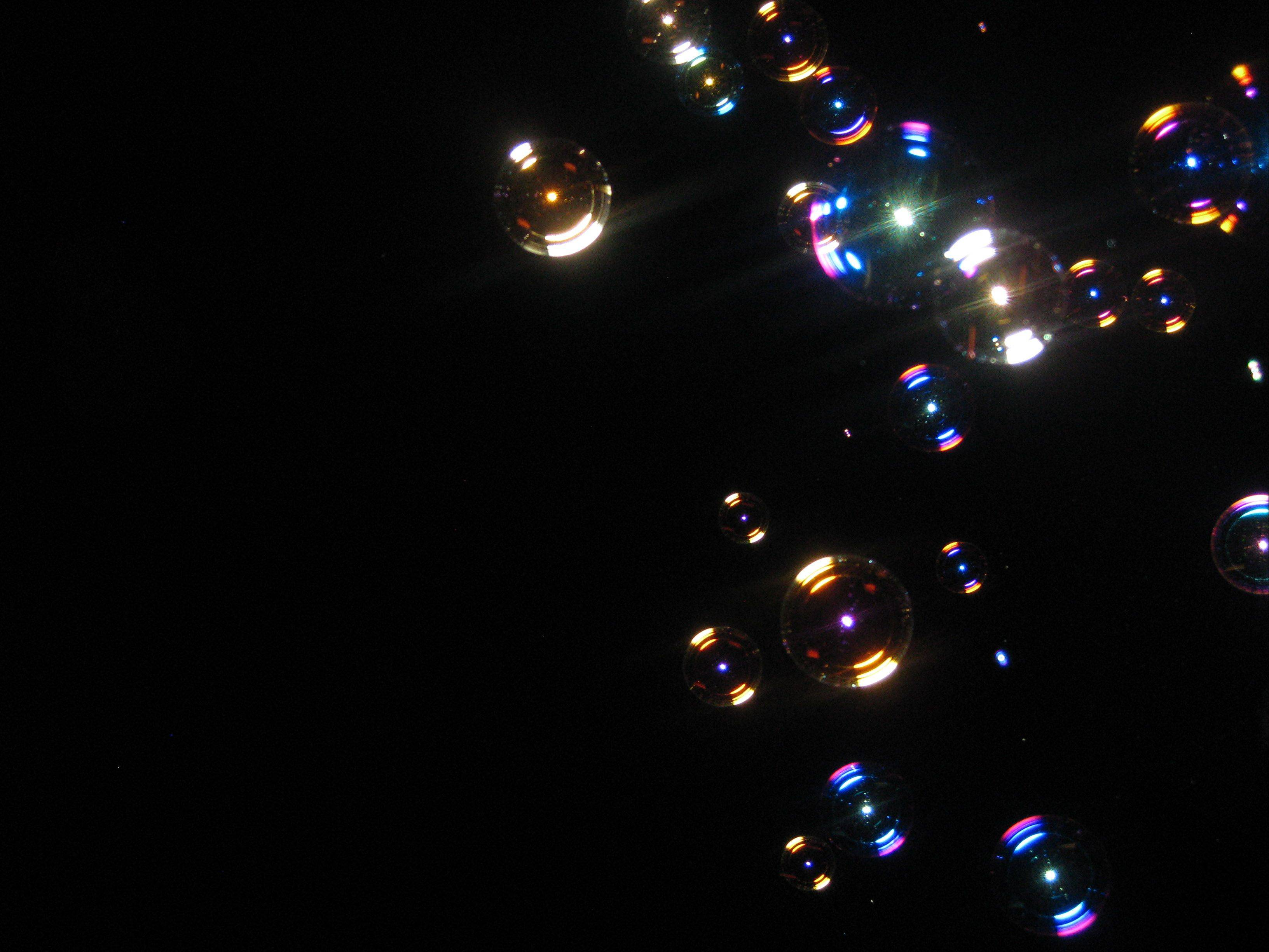 Sitting on our deck at night, my son blew these bubbles. I grabbed my camera to capture these beautiful orbs floating into the evening sky.