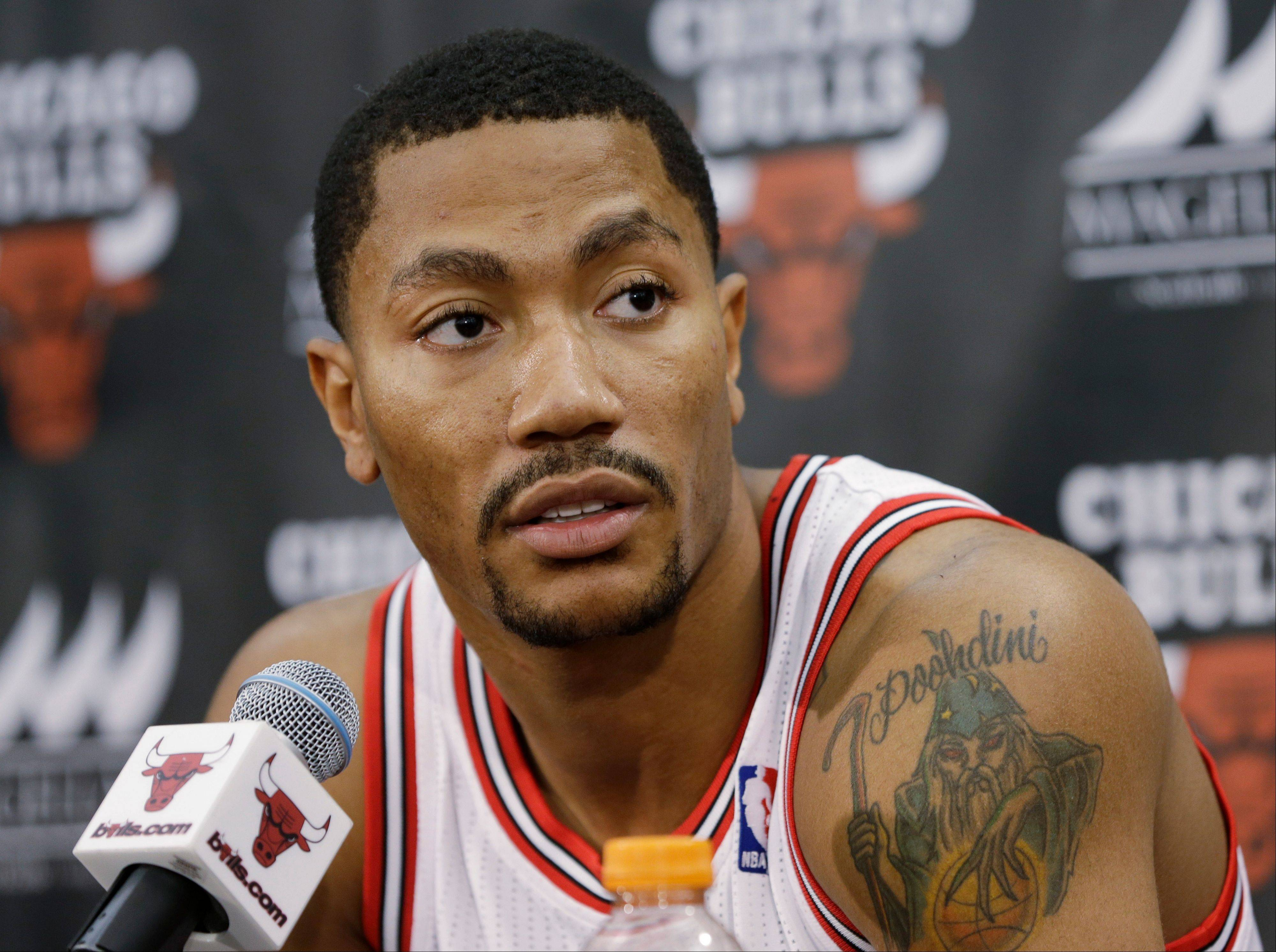 Bulls guard Derrick Rose, who missed last season after tearing an ACL in a playoff game in 2012, says he expects to perform at the same level as before the injury. He also said he has extended his shooting range and has more confidence in his game than ever before.