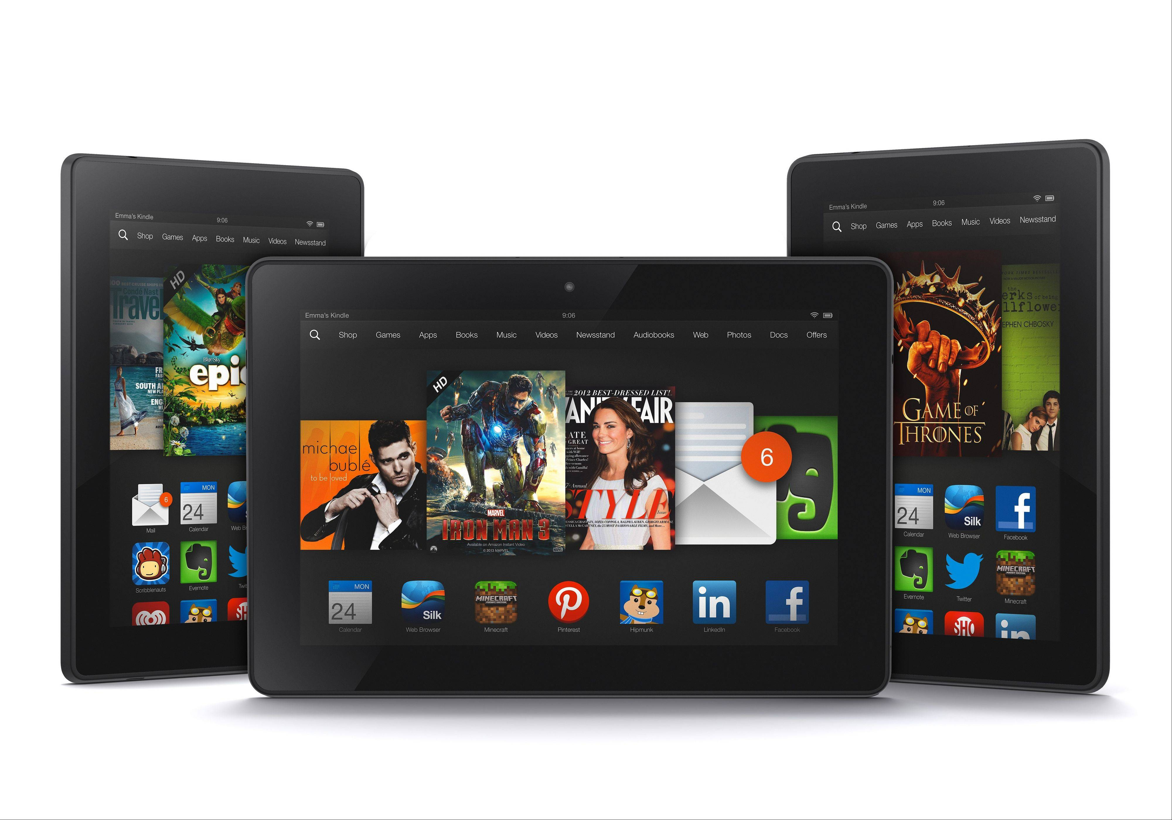This product image provided by Amazon.com on Tuesday shows the new 8.9-inch Amazon Kindle HDX tablet computer, center, the 7-inch Kindle HDX, left, and the updated Kindle HD. Amazon has refreshed its lineup of tablets with new HDX devices, which are significantly faster and lighter than the previous generation.