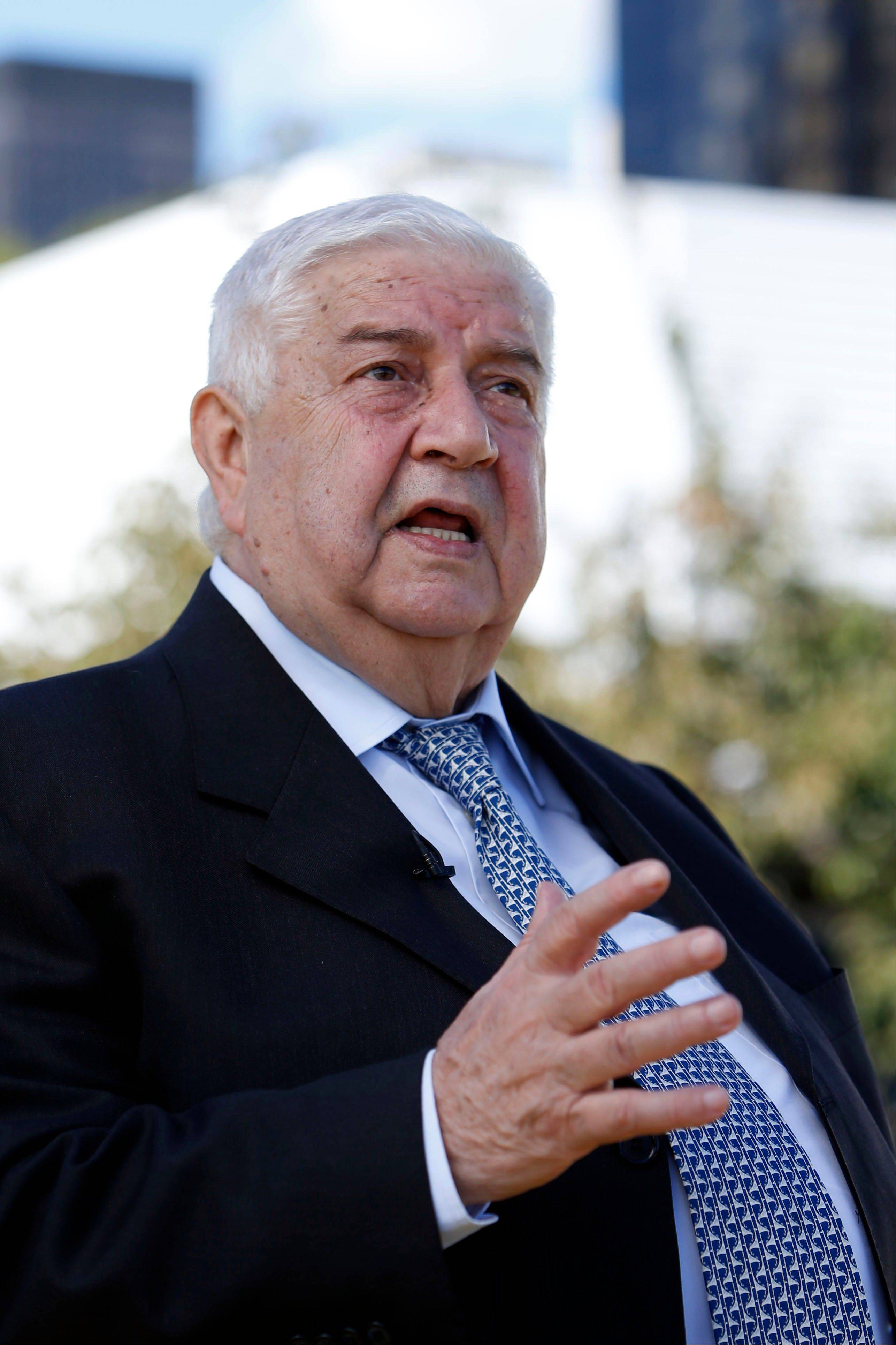 Syrian Foreign Minister Walid al-Moallem gives an interview Saturday during the 68th session of the United Nations General Assembly at U.N. headquarters.