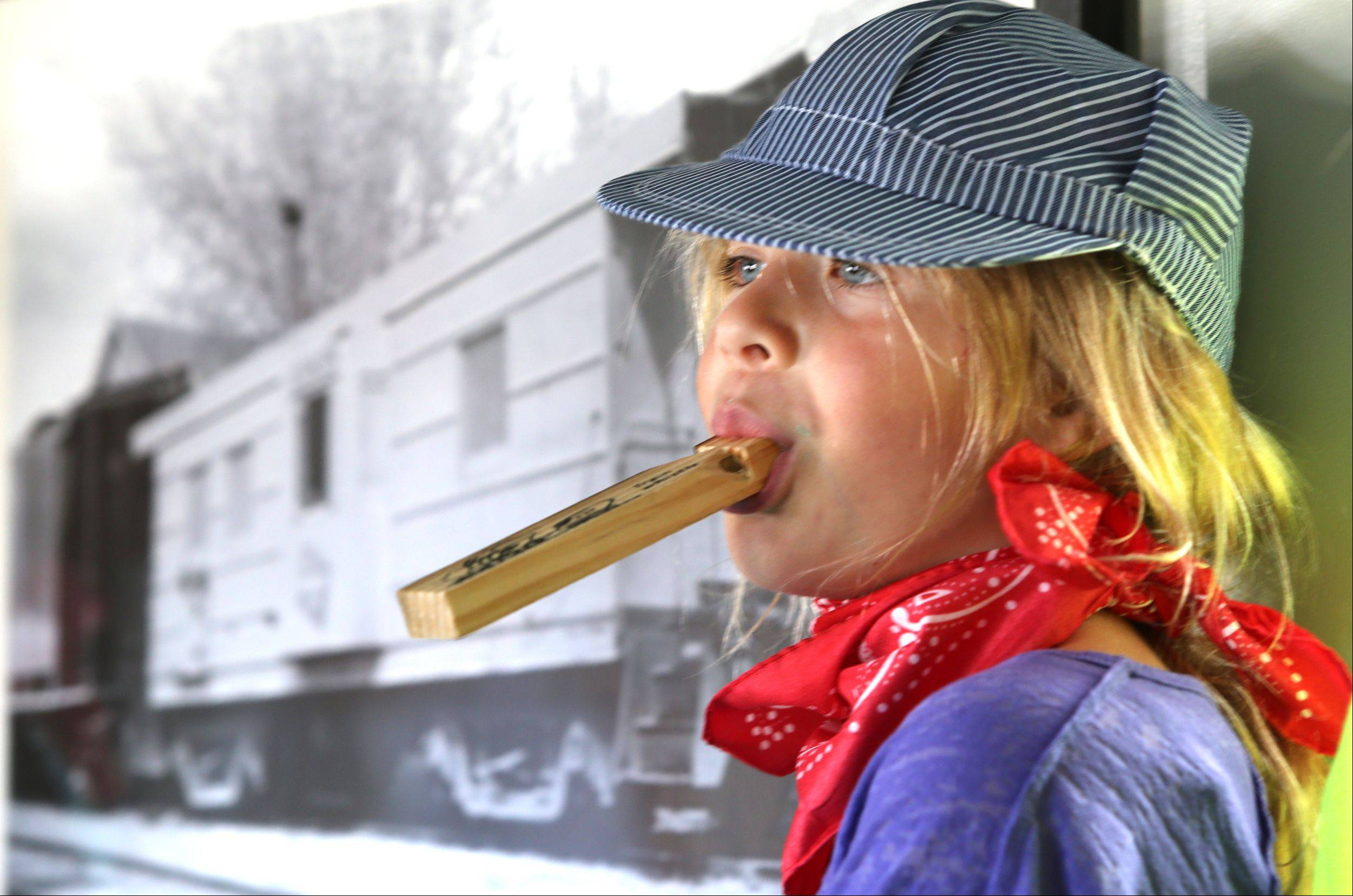 Hannah Gelinas, 8, of Arlington Heights tours a 74-year-old newly restored caboose as the Itasca Historical Depot Museum hosts its grand reopening event.