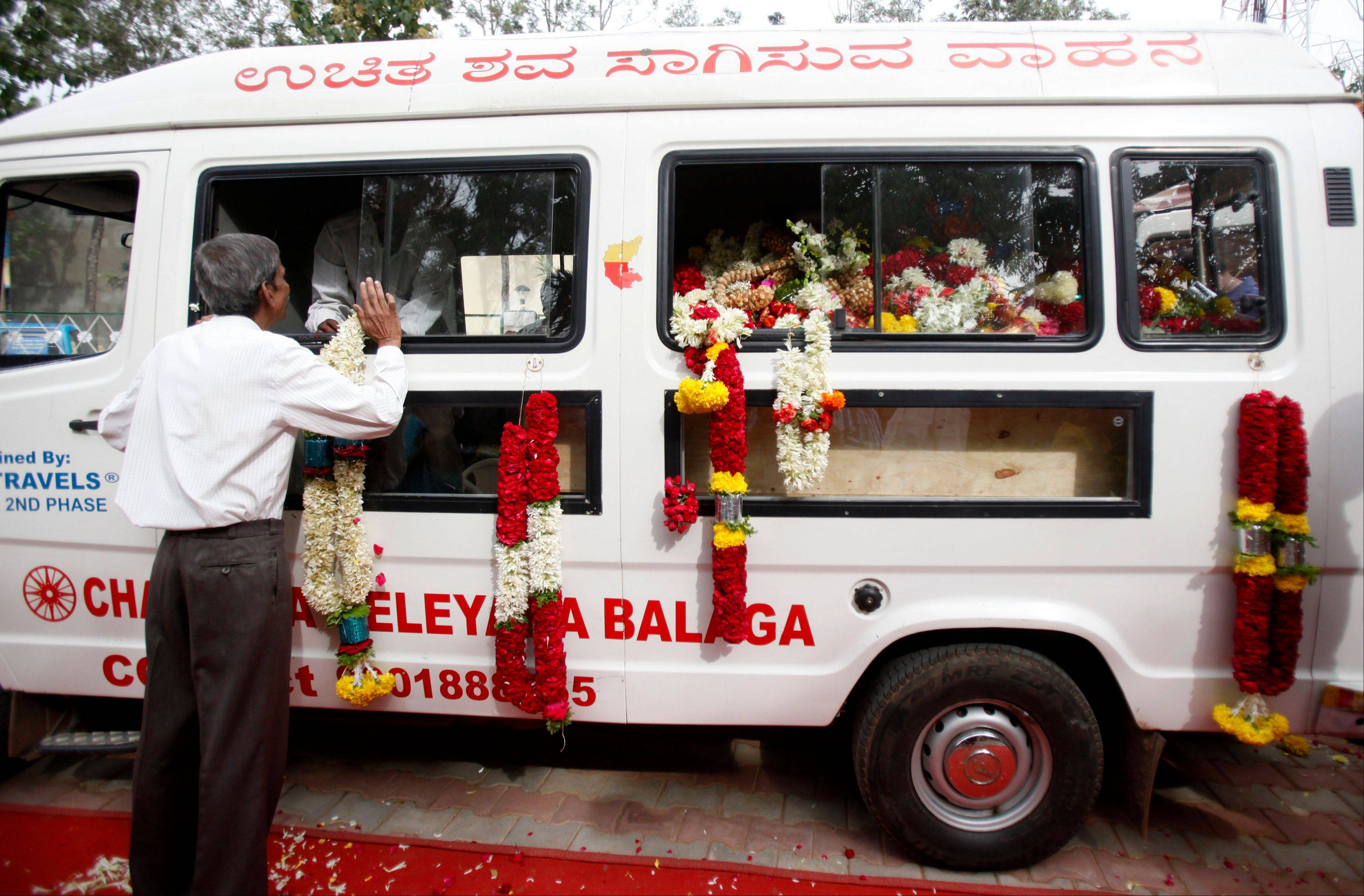 Garlands hang from an ambulance carrying the coffin of Sudharshan B. Nagaraj, who died in an attack on Westgate Mall in Nairobi, Kenya, before his body was taken for cremation, in Hejjala, 19 miles from Bangalore, India, Saturday, Sept. 28. Almost a week after 67 people were killed in the attack on the upscale shopping center in Nairobi, there is still no clear word on the fate of dozens who have been reported missing and no details on the terrorists who carried it out. Nagaraj was in Nairobi on a business trip.