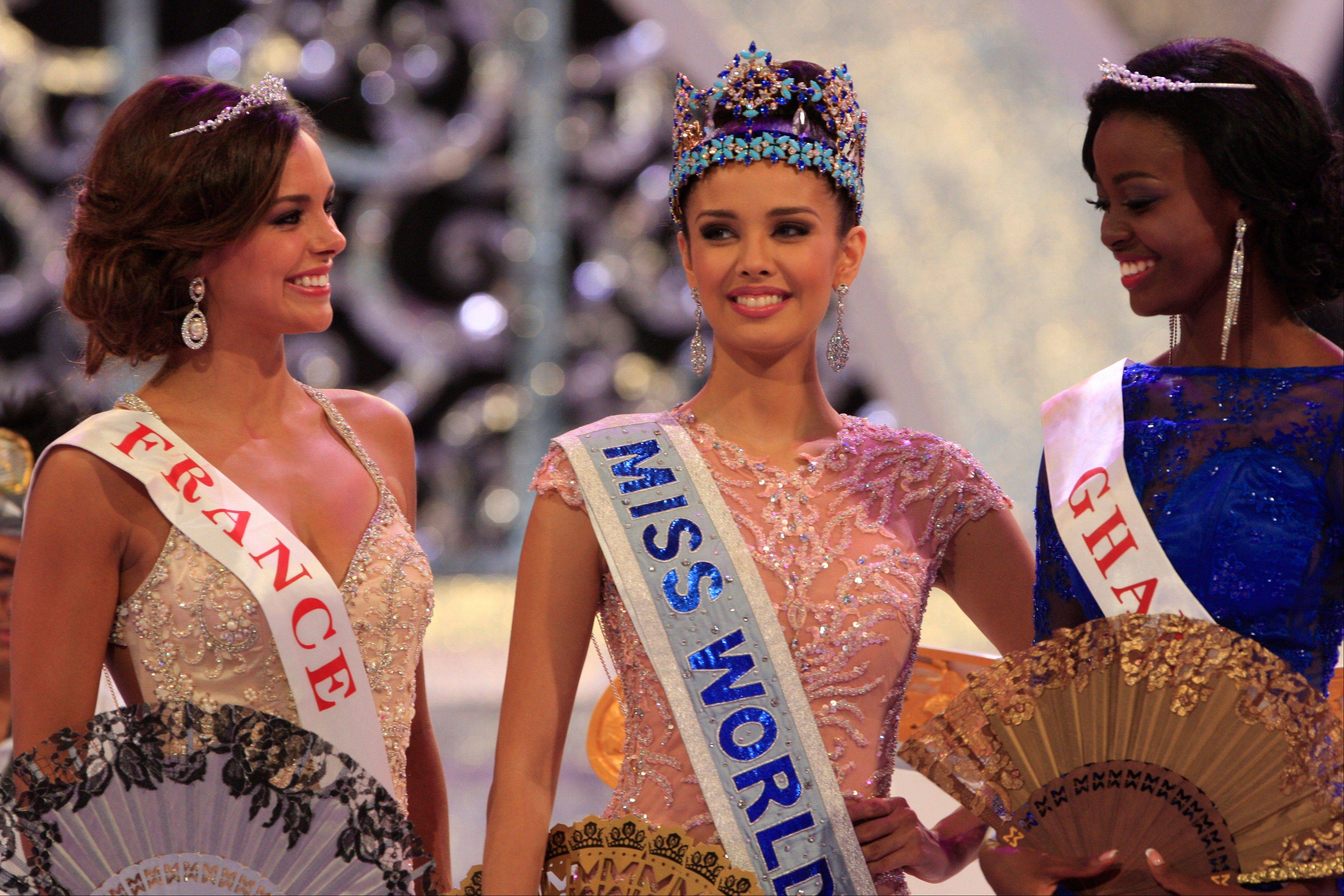 Newly crowned Miss World, Megan Young of Philippines, center, with second runner-up Miss France Marine Lorpheline, left, and third runner-up Miss Ghana Carranza Naa Okailey Shooter, smile after they winning the Miss World contest in Nusa Dua, Bali, Indonesia, Saturday, Sept. 28.