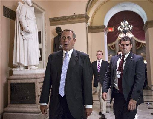 Speaker of the House John Boehner, R-Ohio, walks to the chamber as the House of Representatives works into the night to pass a bill to fund the government, at the Capitol in Washington, Saturday, Sept. 28, 2013. Locked in a deepening struggle with President Barack Obama, House Republicans on Saturday demanded a one-year delay in major parts of the nation's new health care law and permanent repeal of a tax on medical devices as the price for preventing a partial government shutdown threatened for early Tuesday.