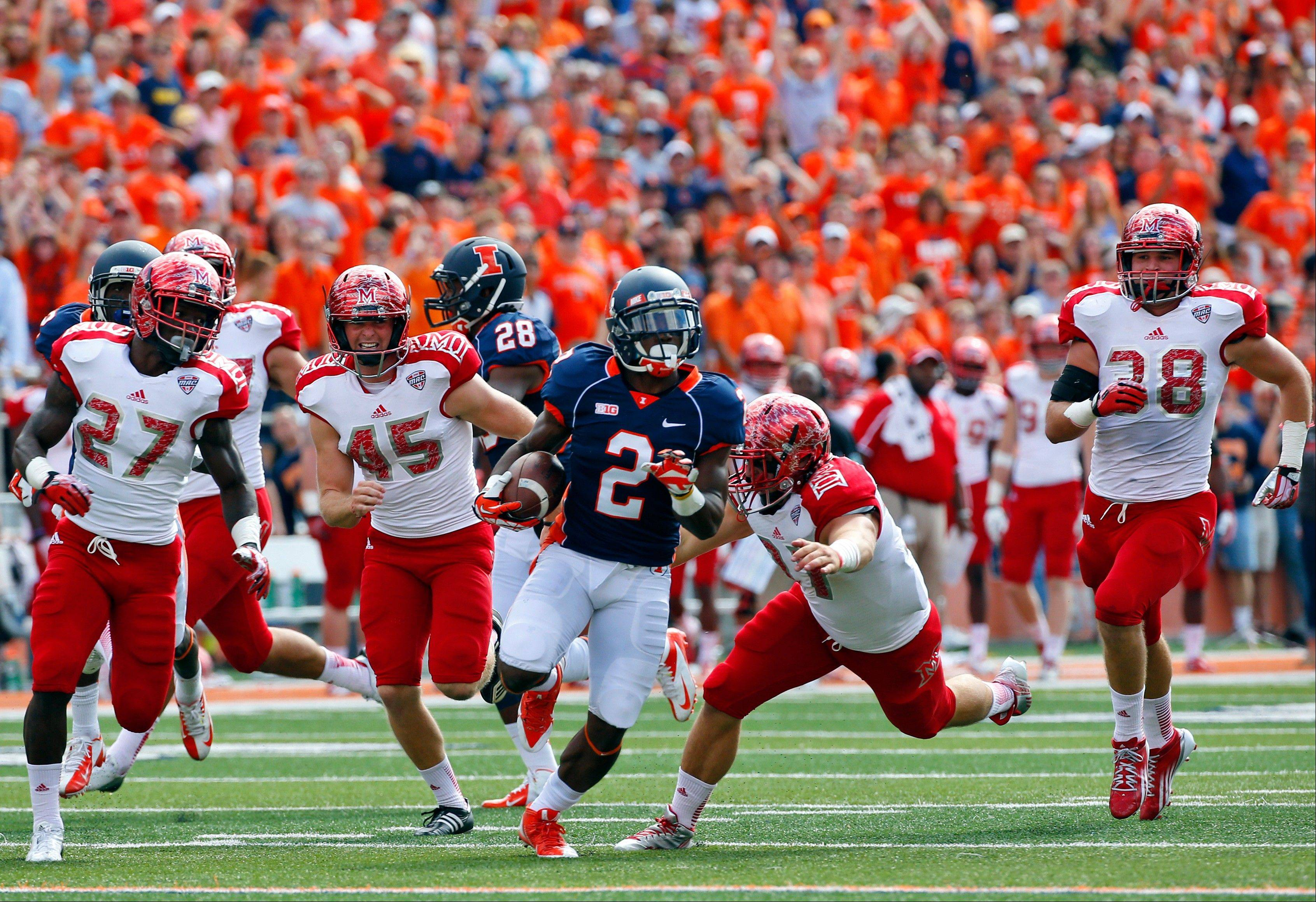 Illinois punt returner V'Angelo Bentley (2) is chased down by Miami (Ohio) defensive back Jarrell Jones (27) kicker Zac Murphy (45), running back Grant Niemiec (37) and linebacker Tyler Tucker (38) during the first half of an NCAA college football game on Saturday, Sept. 28, 2013, at Memorial Stadium in Champaign, Ill. (AP Photo/Jeff Haynes)