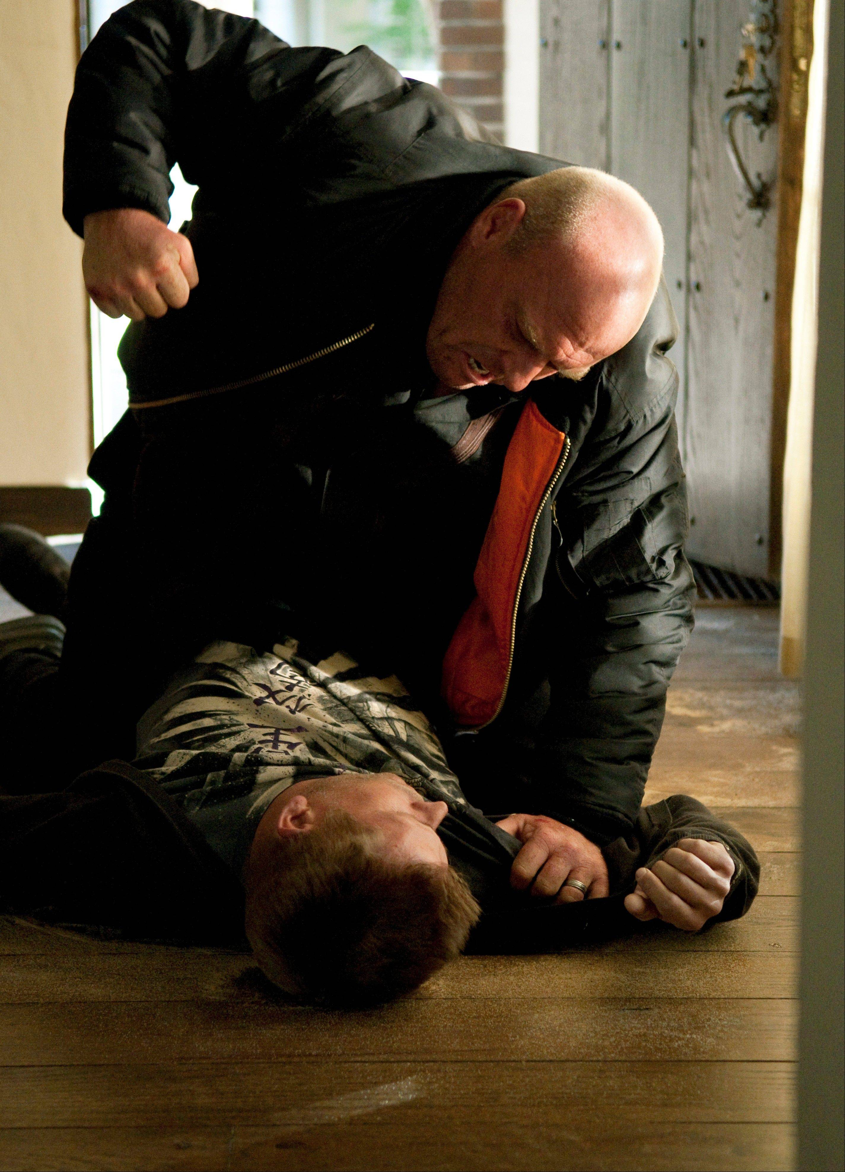 "Hank Schrader (Dean Norris) and Jesse Pinkman (Aaron Paul) air some grievances in a scene from the third season of ""Breaking Bad."""