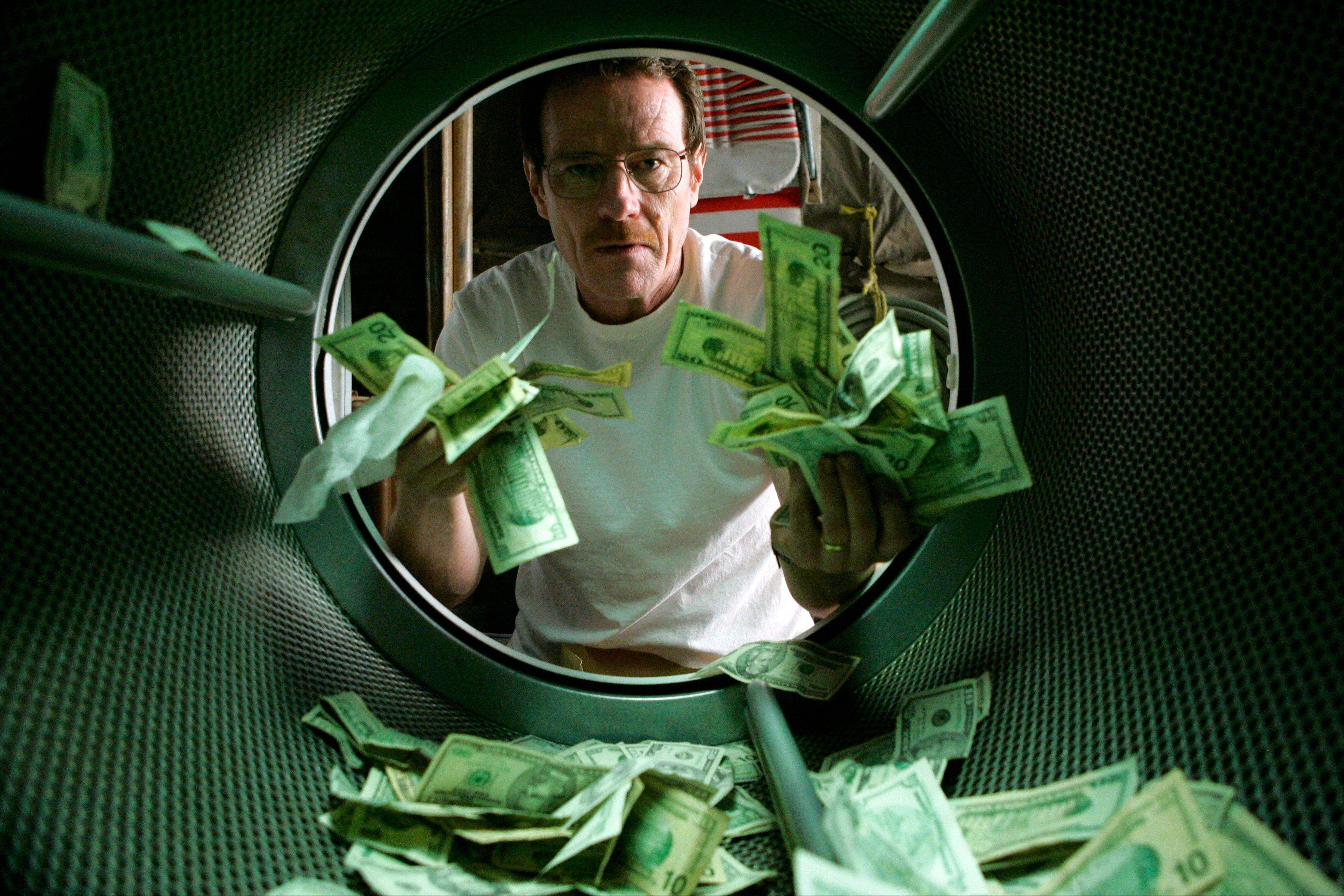 "Walter White (Bryan Cranston) literally launders money in the pilot episode of ""Breaking Bad."" The series finale airs Sunday."