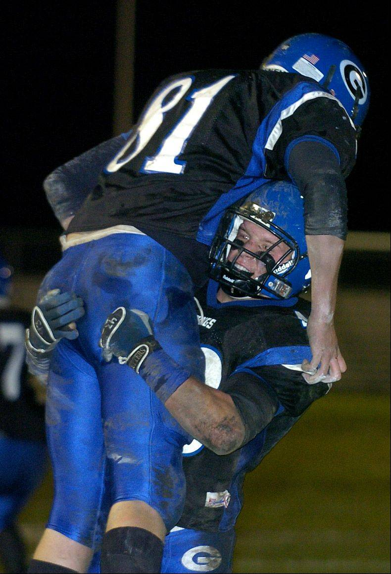 Geneva's Patrick Schiller hoists receiver Aaron O'Connell after a touchdown catch in a 2006 playoff game victory in Geneva.