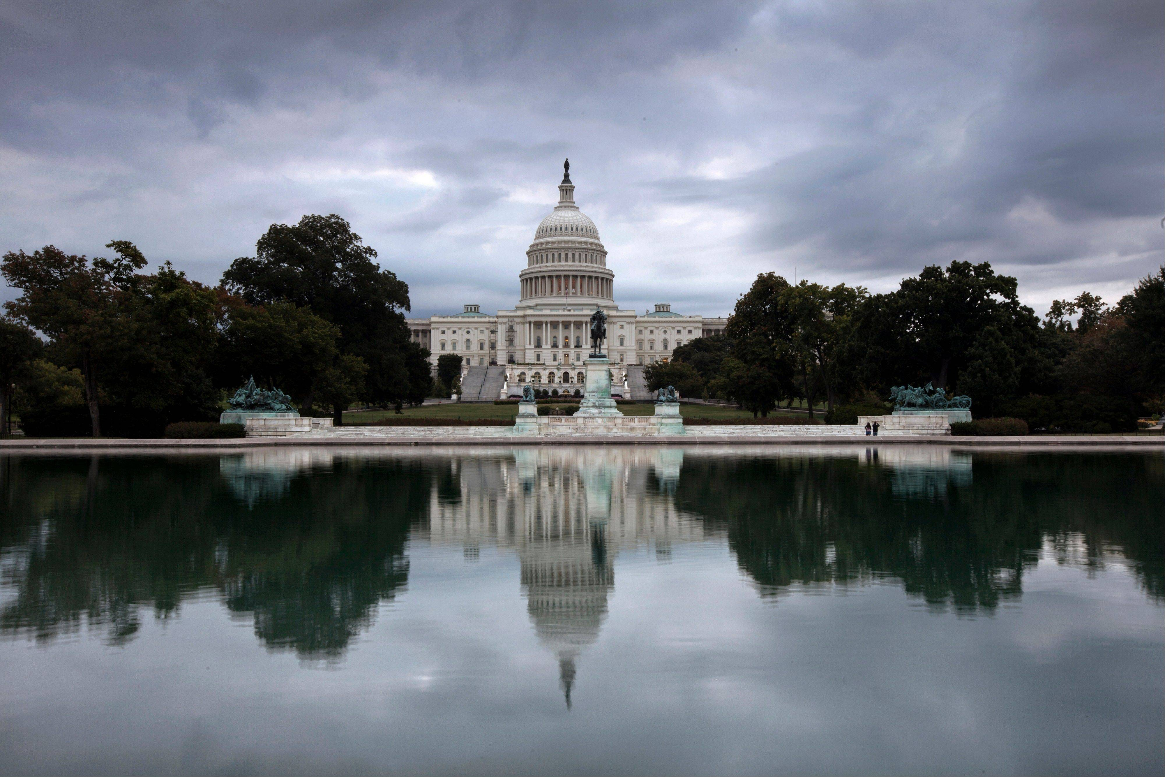 Storm clouds hang over Capitol Hill in Washington Friday as the Republican-controlled House and the Democrat-controlled Senate stand at an impasse with Congress continuing to struggle over how to fund the government and prevent a possible shutdown. Congress failed to avert a shutdown Monday.