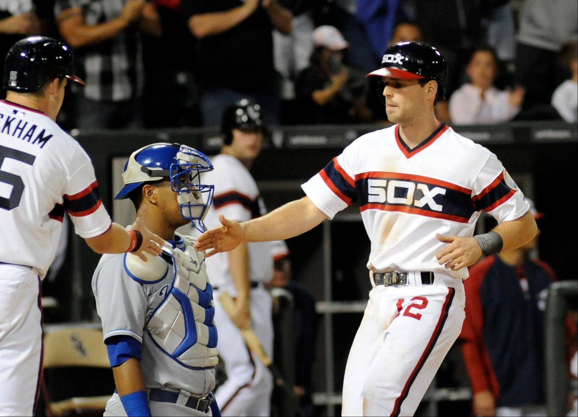 Chicago White Sox's Connor Gillaspie, right, is congratulated by Gordon Beckham after hitting a home run in the seventh inning of a baseball game against the Kansas City Royals Saturday in Chicago.