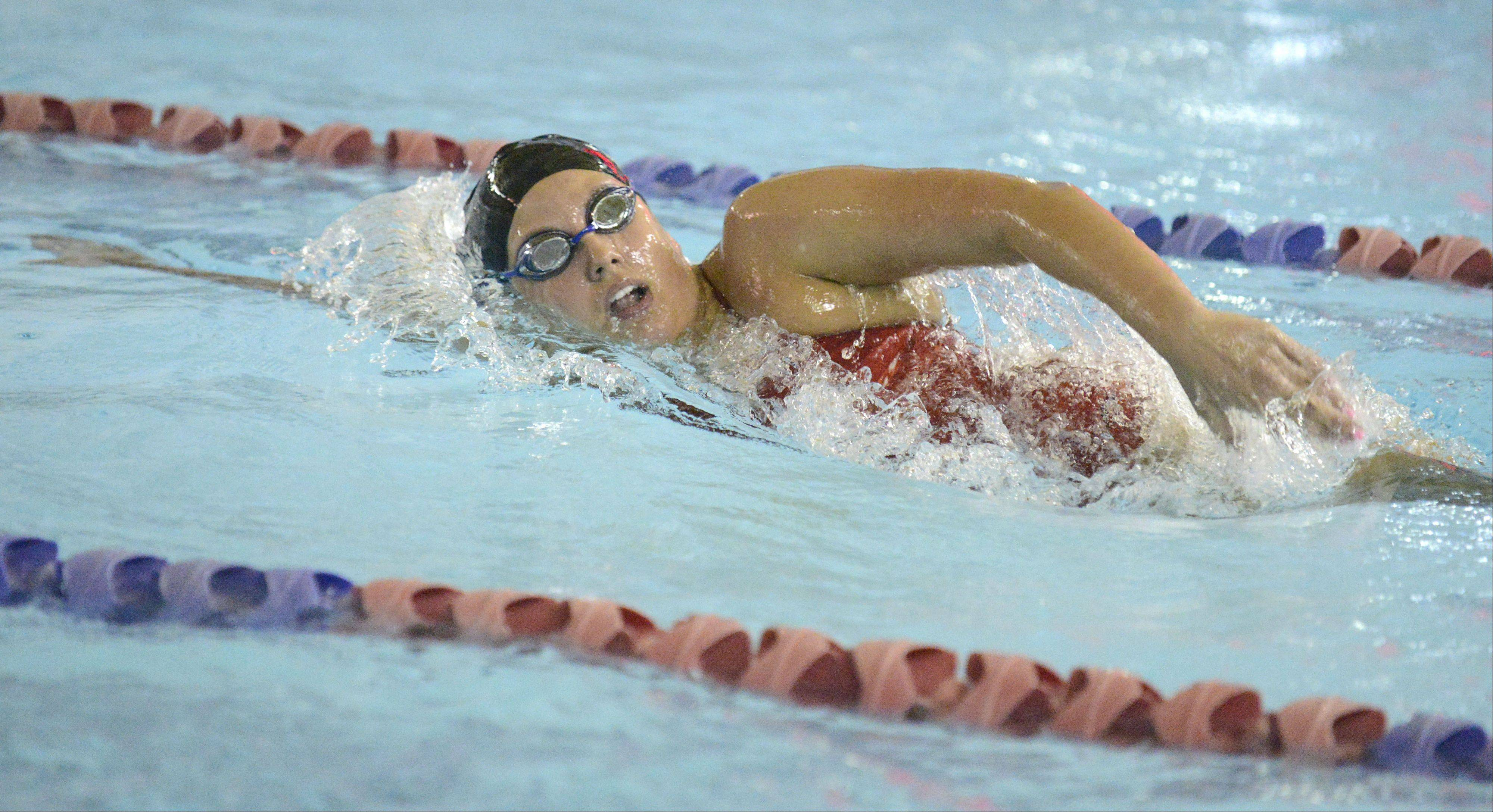 Naperville Central's Kelley Lehane takes first place in the second heat of the 500 yard freestyle at the Rosary Invitational on Saturday, September 28.