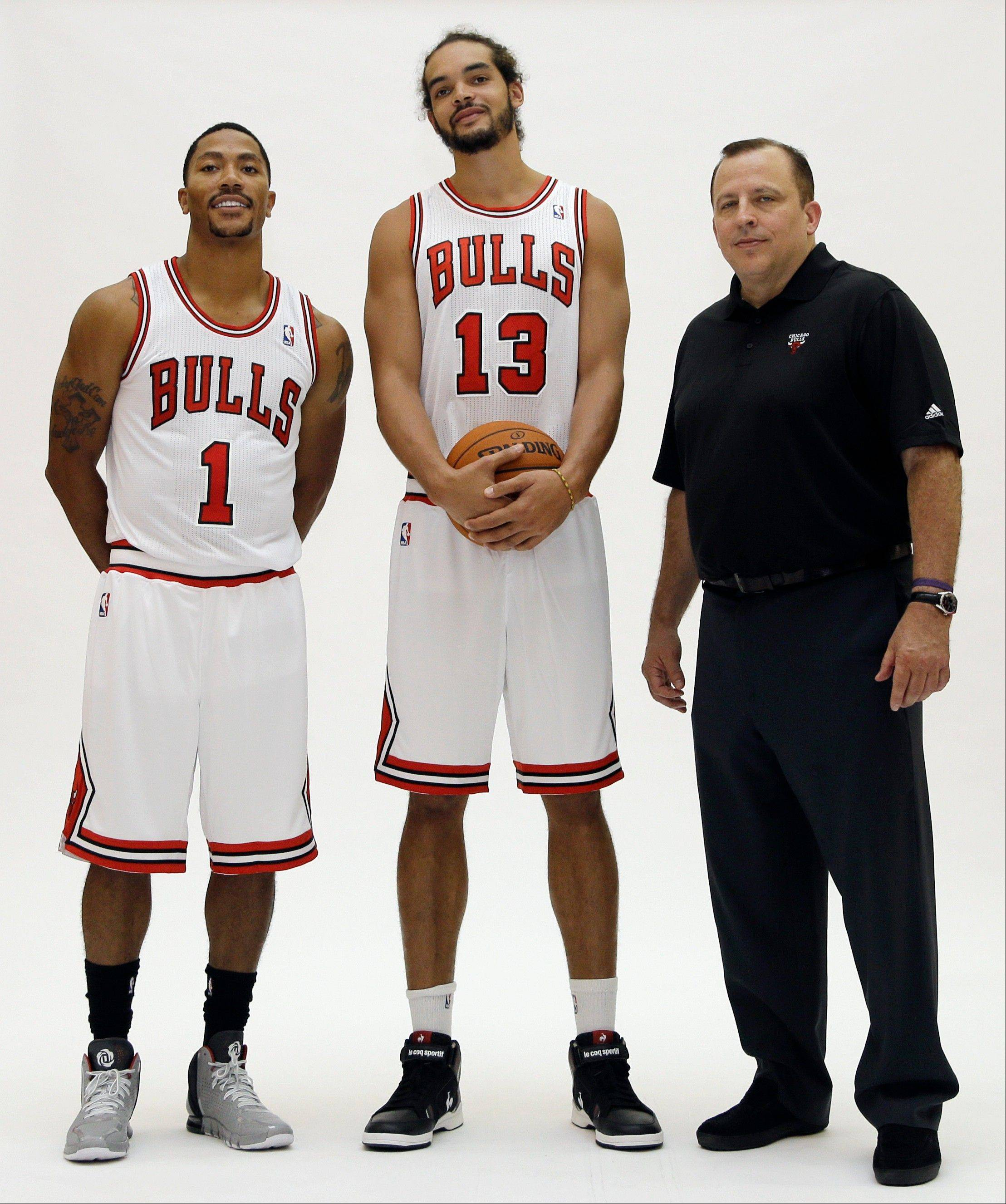 Bulls guard Derrick Rose, left, center/forward Joakim Noah, center, and head coach Tom Thibodeau pose for photos during NBA basketball media day at the Sheri L. Berto Center on Friday, Sept. 27, 2013., in Deerfield, Ill.