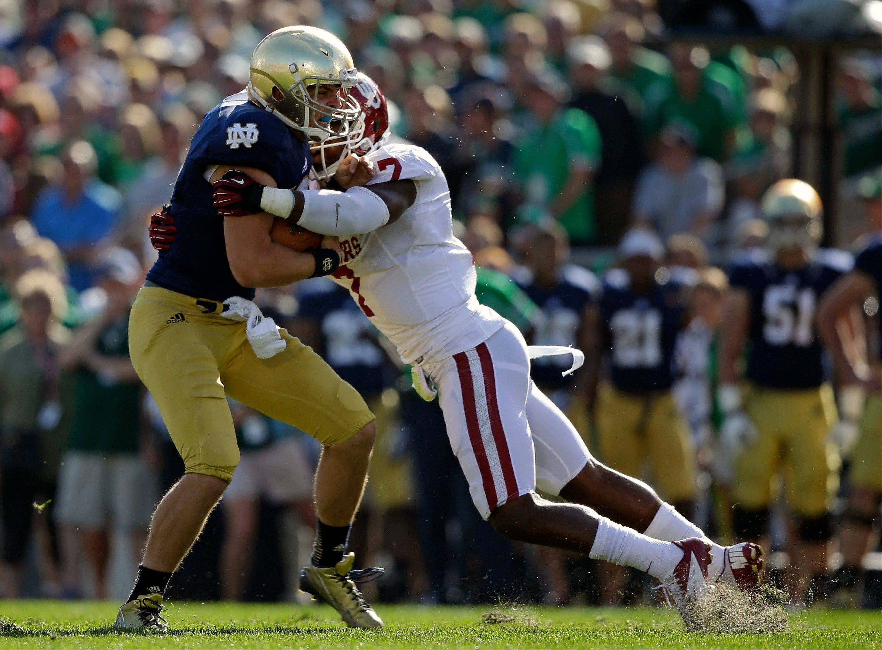 Notre Dame's Andrew Hendrix, left, is tackled by Oklahoma's Corey Nelson (7) during the matchup in South Bend, Ind. Saturday.