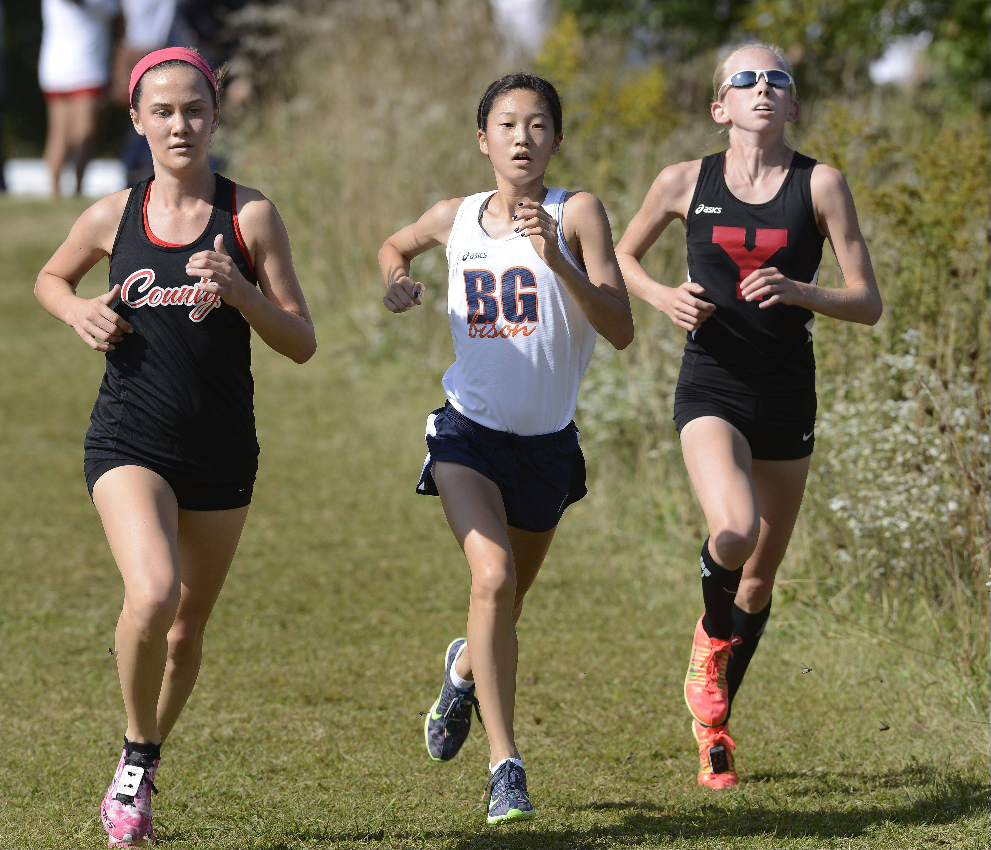 Buffalo Grove's Kaitlyn Ko, who finished second, runs between eventual winner Whitney O'Bryan, left, of Daviess County Kentucky and third-place finisher Skyler Bollinger of Yorkville during the Palatine Invitational at Deer Grove East on Saturday.