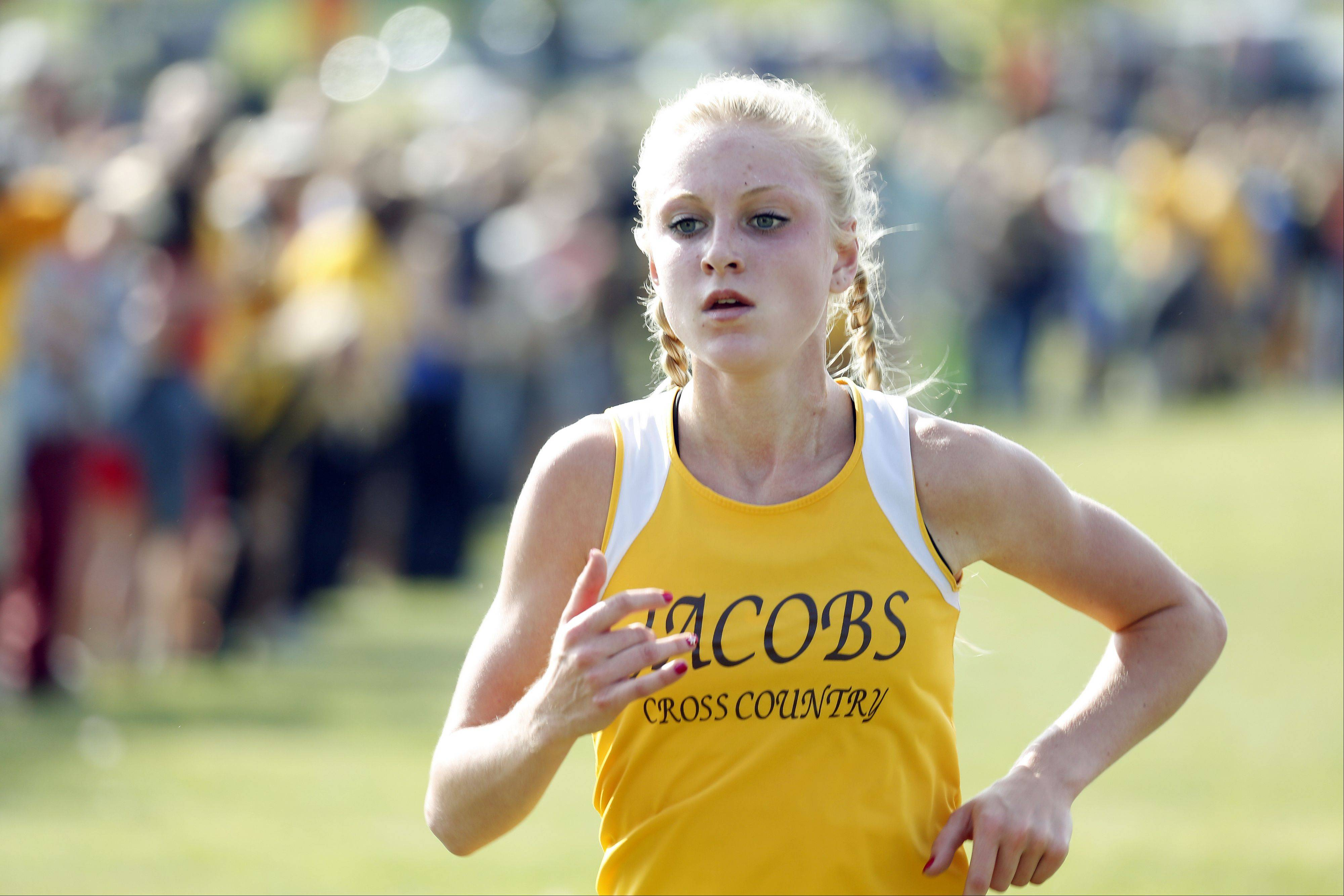 Jacobs' Lauren Van Vlierbergen has her eye on first place as she crosses the finish line during the Flyin' Hawk Cross Country meet Saturday at Sunrise Park in Bartlett.