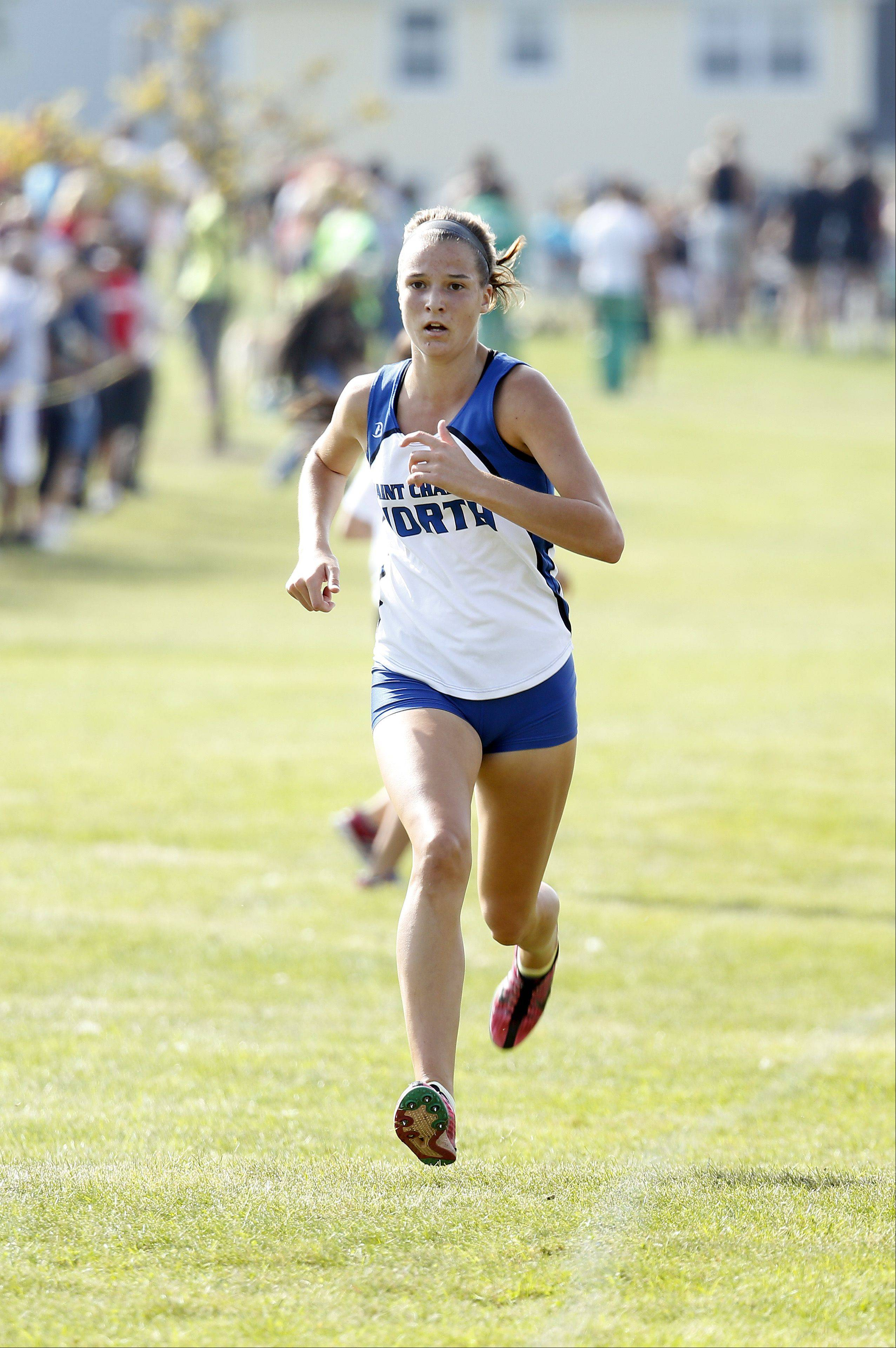 St. Charles North's Ashley England finishes second during the Flyin' Hawk Cross Country meet Saturday at Sunrise Park in Bartlett.