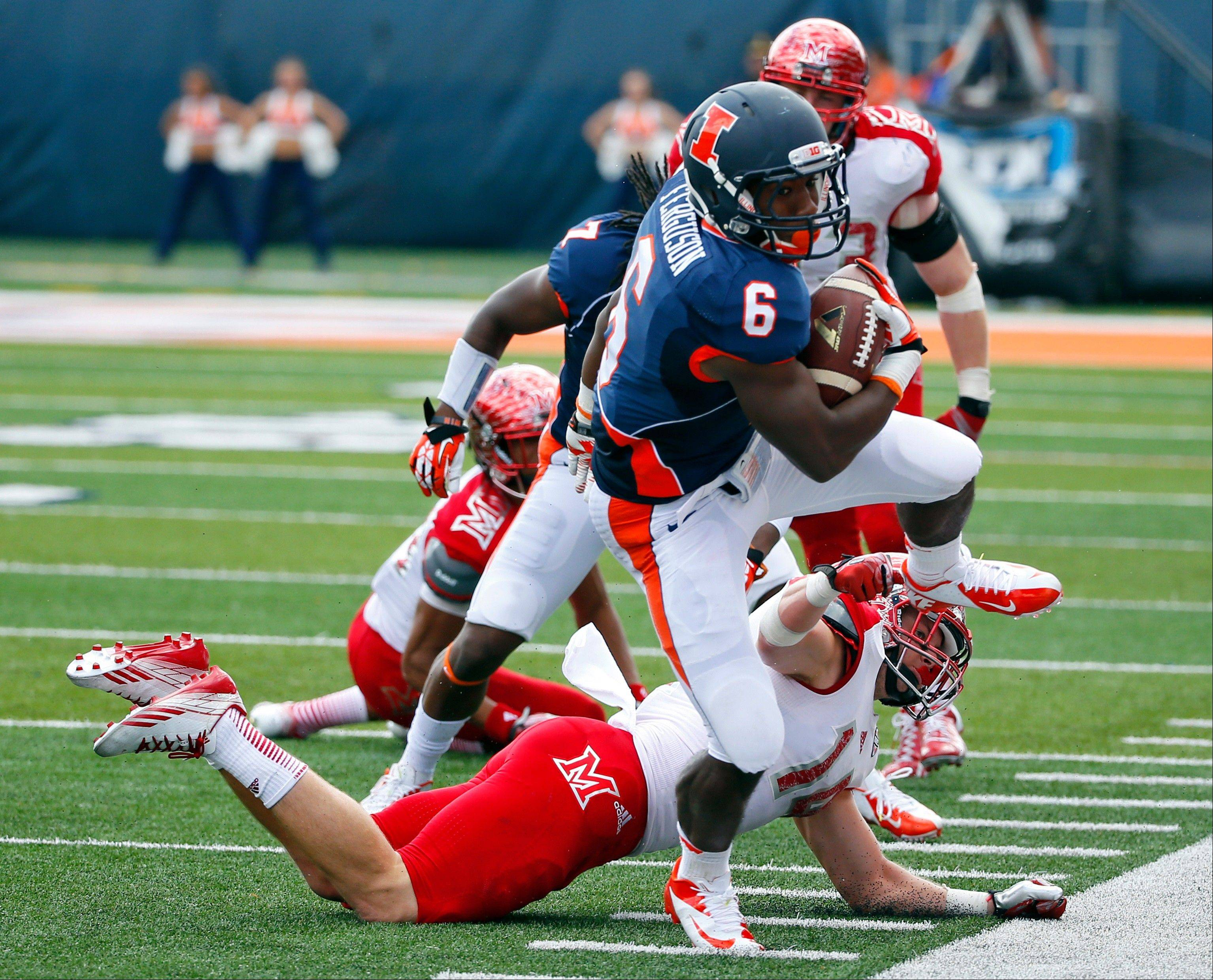 Illinois running back Josh Ferguson (6) is forced out of bounds by Miami (Ohio) defensive back Jay Mastin (14) during the first half of an NCAA college football game on Saturday, Sept. 28, 2013, at Memorial Stadium in Champaign, Ill.