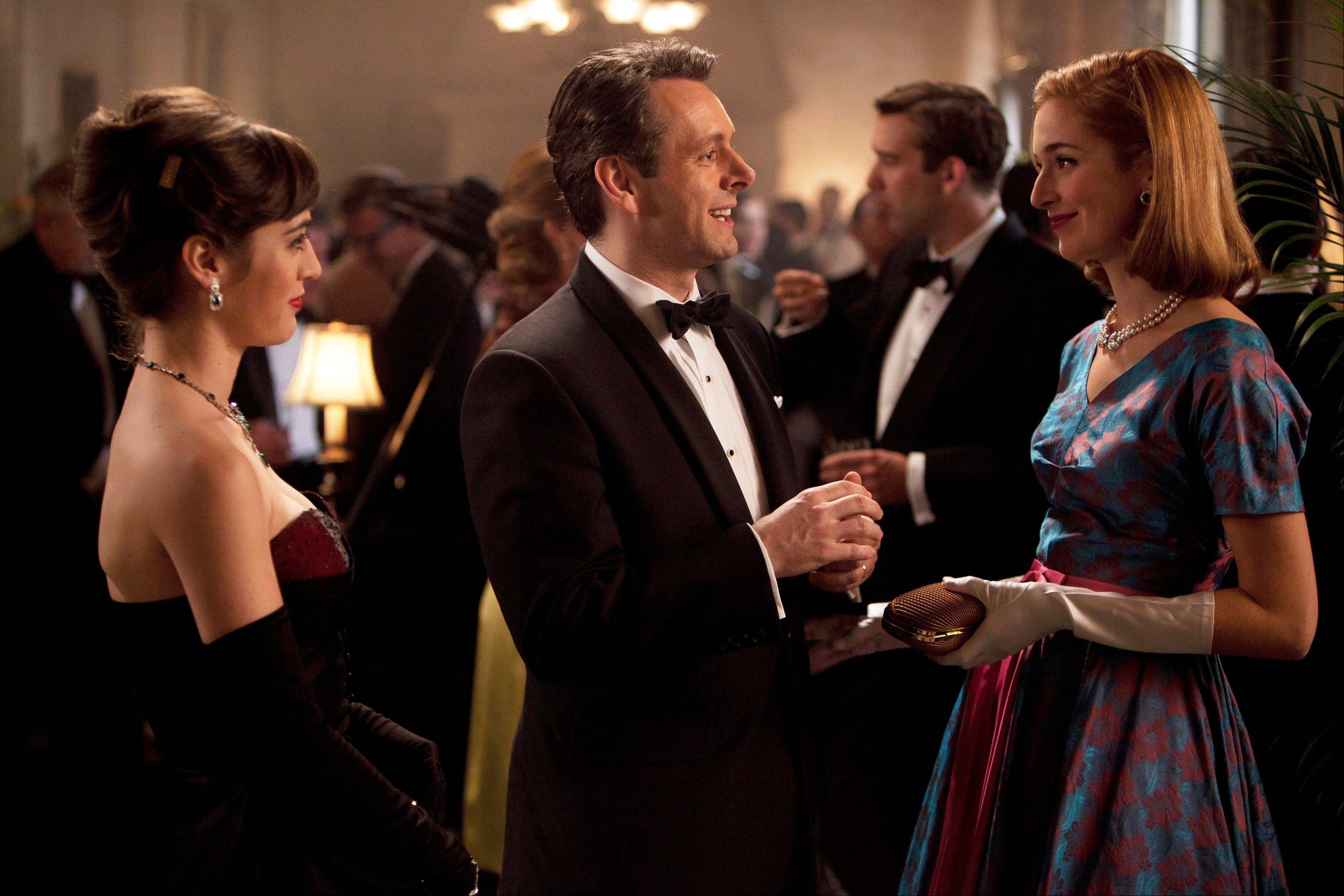 Lizzy Caplan, left, plays Virginia Johnson, Michael Sheen is Dr. William Masters and Caitlin Fitzgerald plays Libby Masters in Showtime�s �Masters of Sex.�