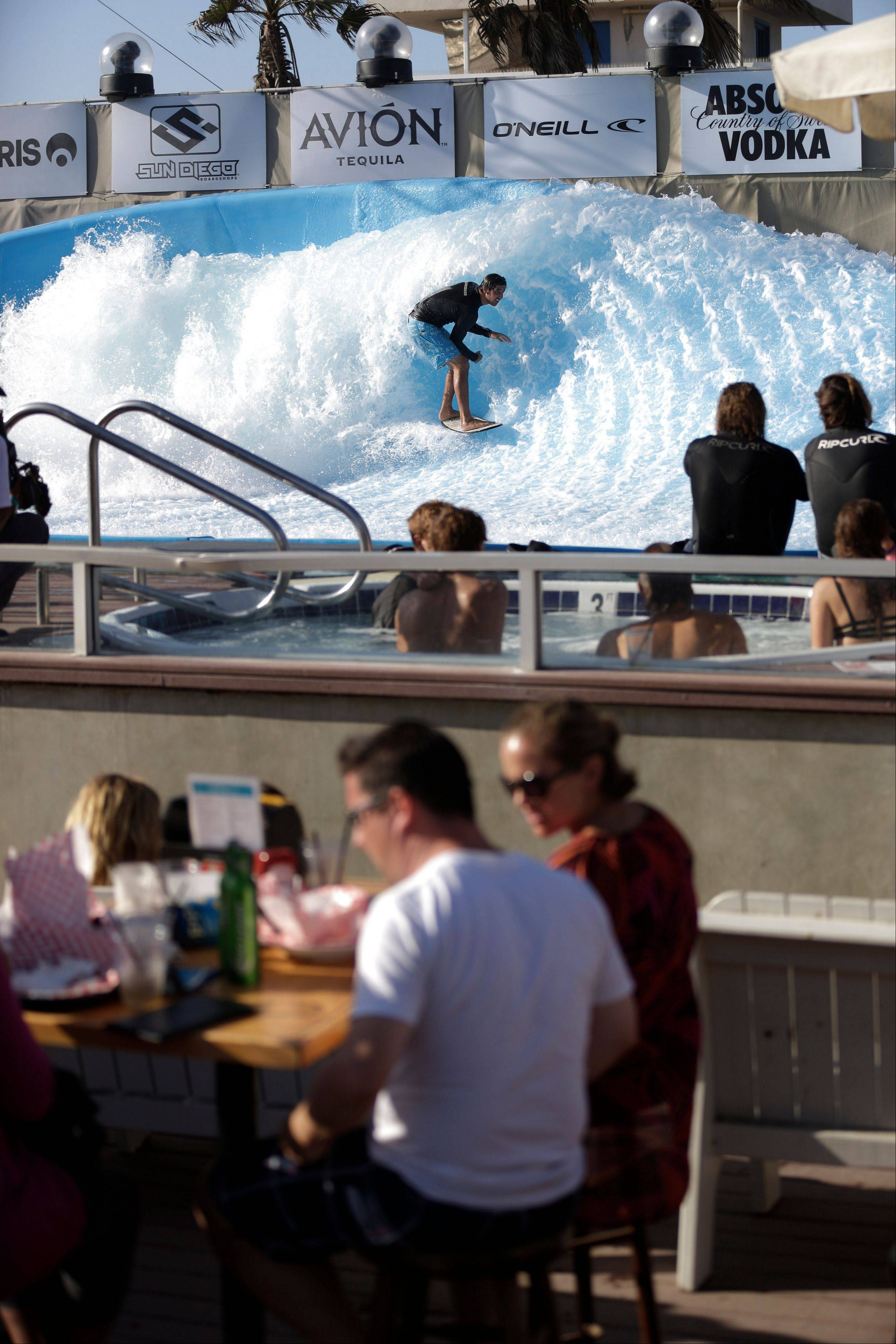 A surfer rides the machine-made wave at Wavehouse San Diego. Surf parks � massive pools with repeating, artificial waves � are the latest buzzword in the surf community. Momentum around surf parks has been growing since the 1960s, but fewer than a dozen serious parks currently exist in locations from Florida to Malaysia.