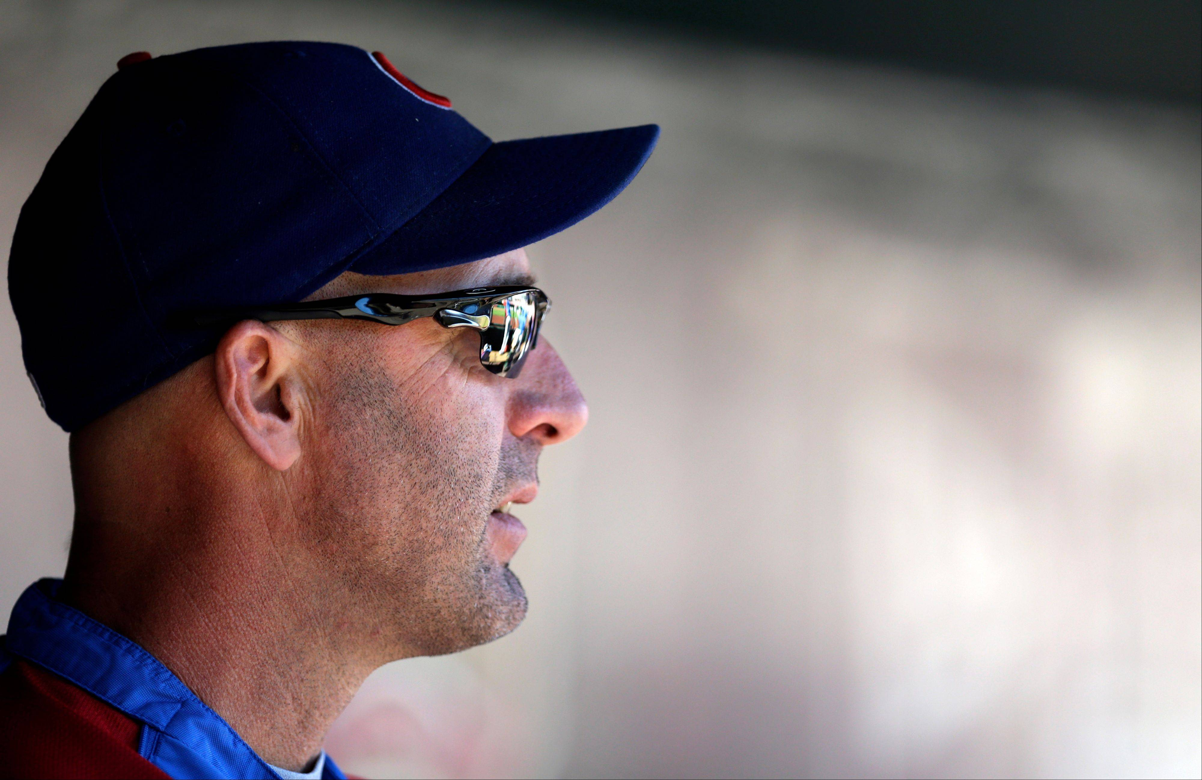 Cubs manager Dale Sveum looks out from the dugout before Sunday�s game against the Cardinals in St. Louis.