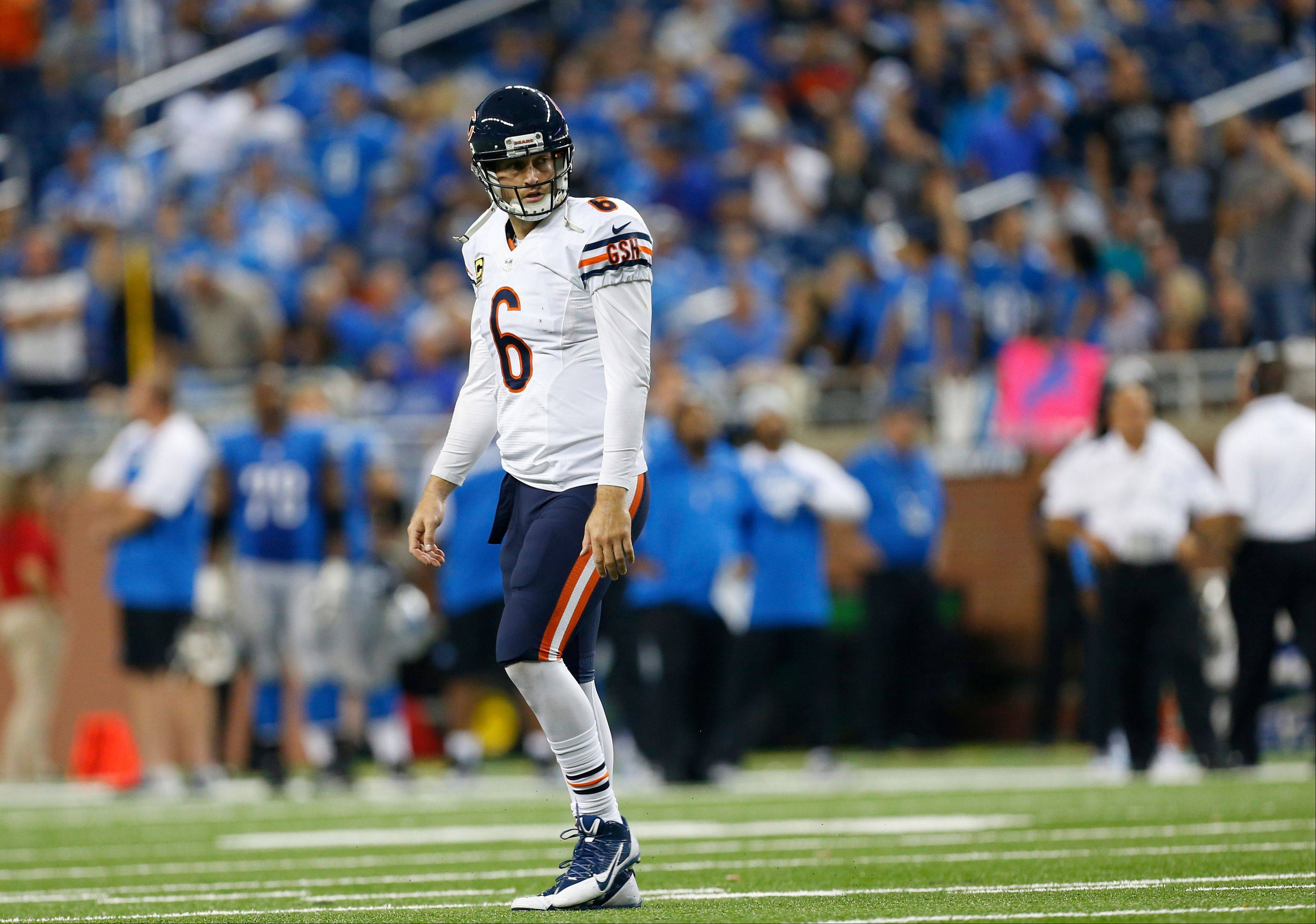 Bears quarterback Jay Cutler walks back to the bench during the fourth quarter of Sunday�s loss to the Lions at Detroit.