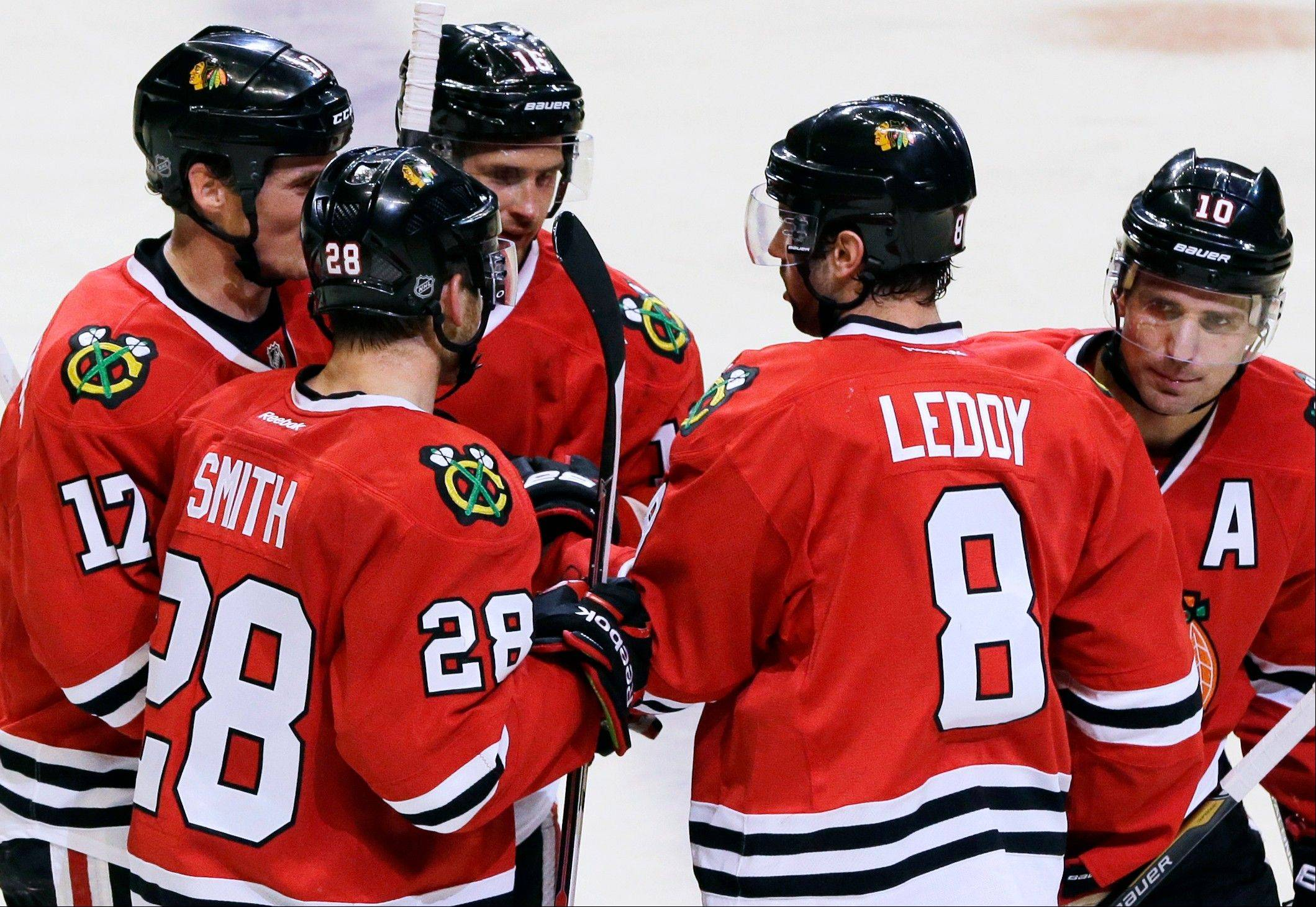 Nick Leddy celebrates with his Blackhawks teammates after scoring his second goal during the second period Saturday night against the Capitals at the United Center.