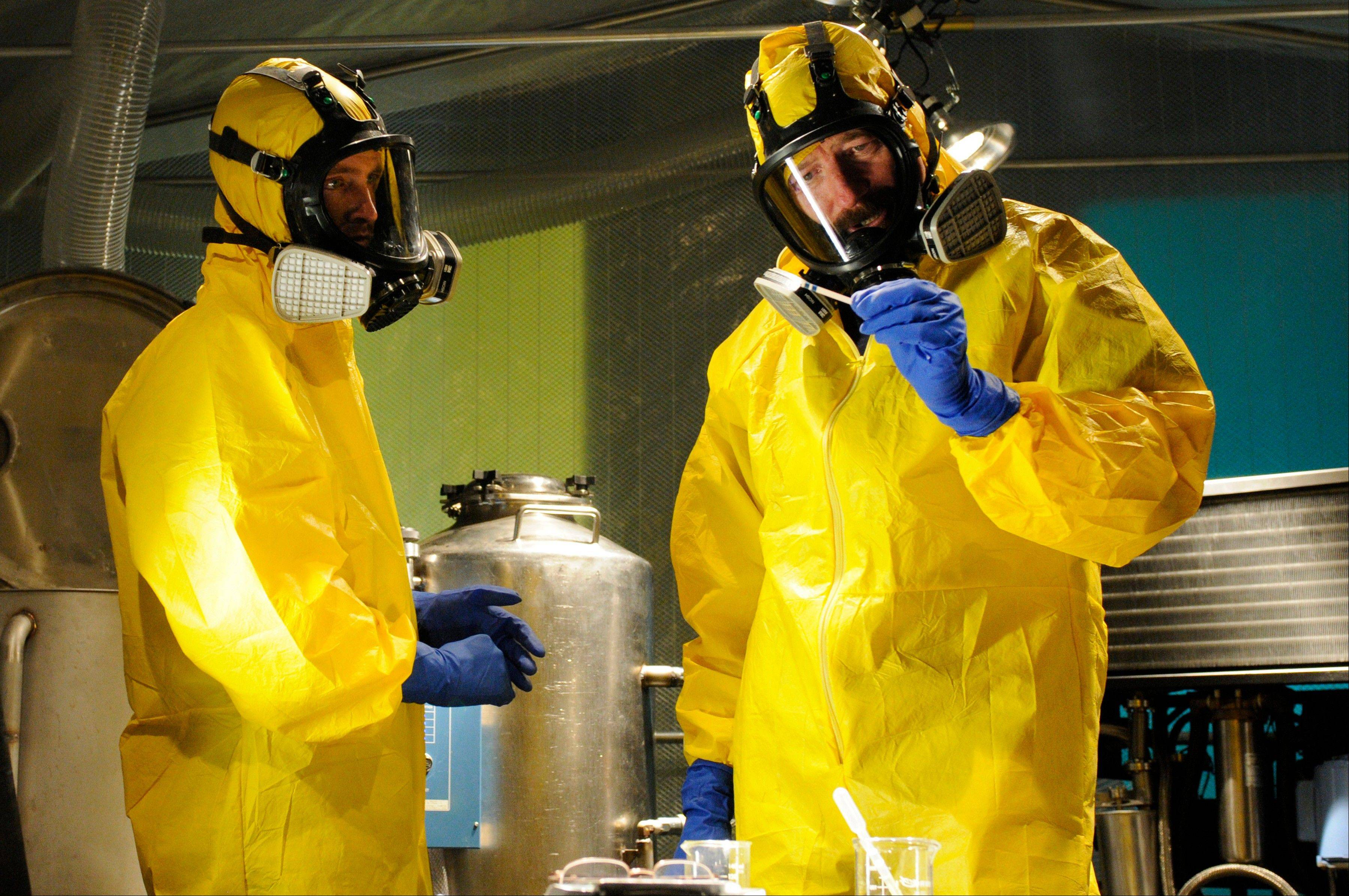 "This image released by AMC shows Jesse Pinkman, played by Aaron Paul, left, and Walter White, played by Bryan Cranston, cooking meth in a home being fumigated in the fifth season of ""Breaking Bad."" The series finale of the popular drama series aired on Sunday."