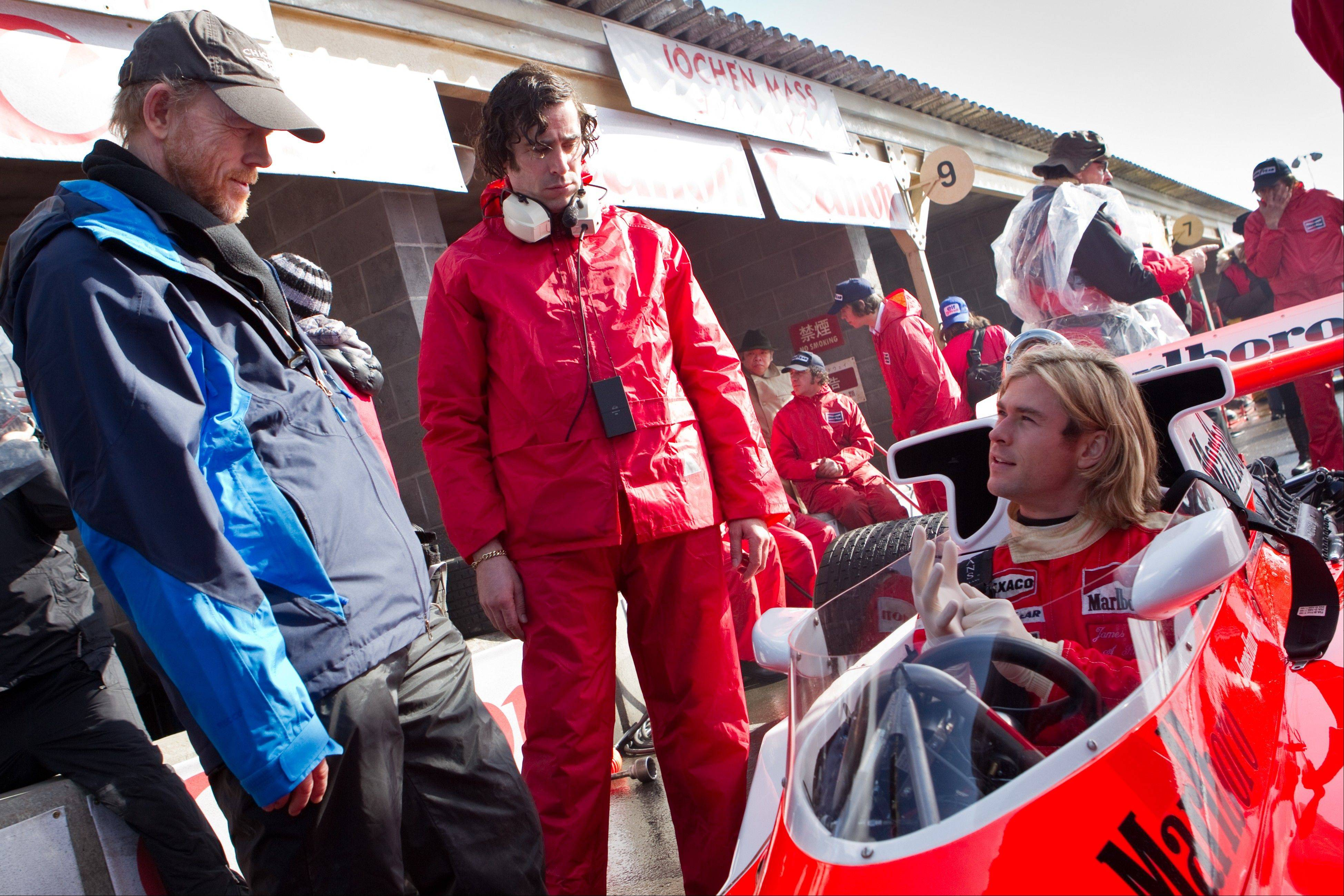 "Ron Howard, left, directs Chris Hemsworth on the set of ""Rush."" The film, chronicling Formula One's 1976 world championship between Niki Lauda and James Hunt, opened Friday."