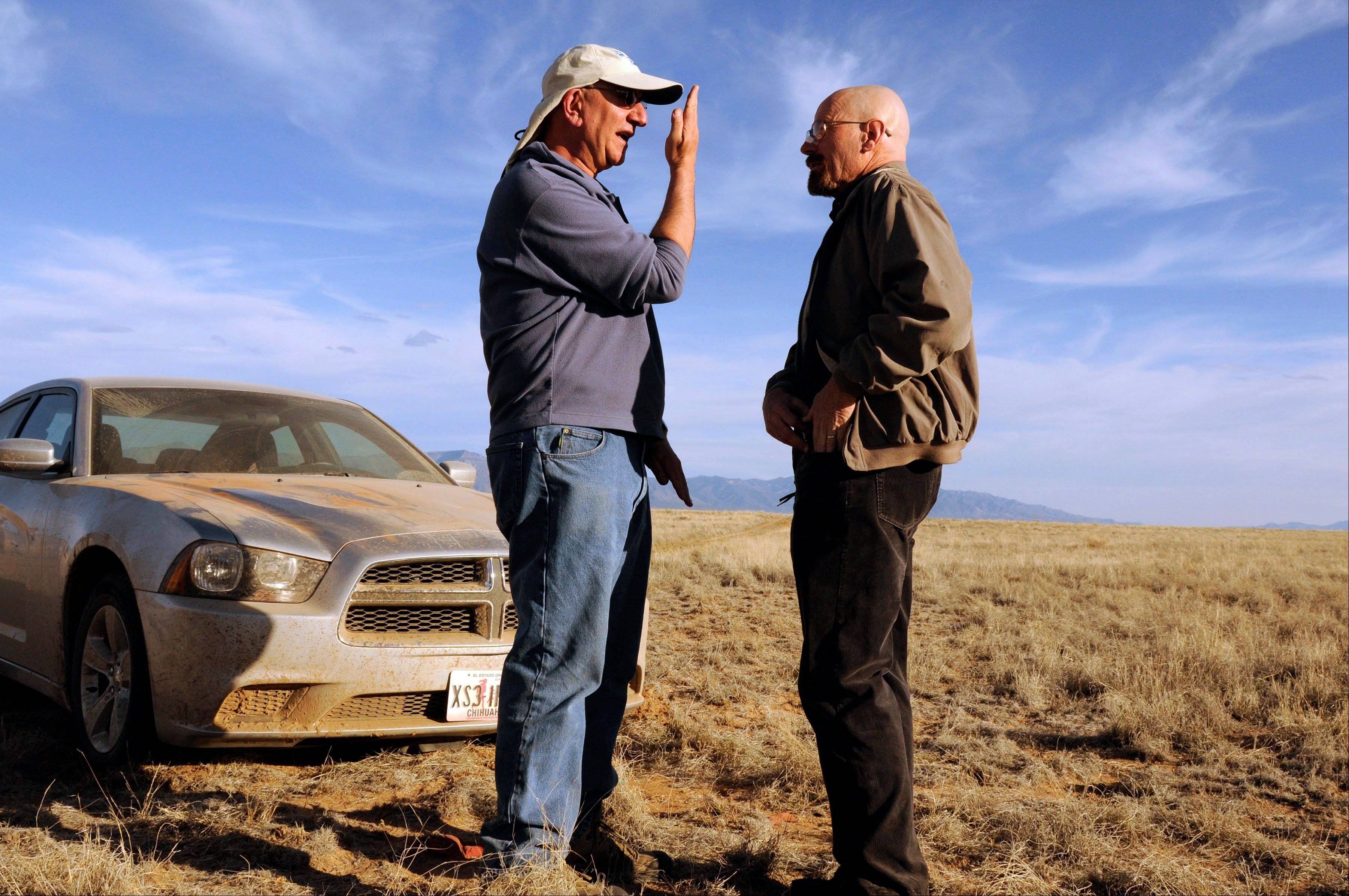 "Cinematographer Michael Slovis, left, gives Bryan Cranston a little direction on the set of ""Breaking Bad."" The series finale will air on Sunday, Sept. 29."