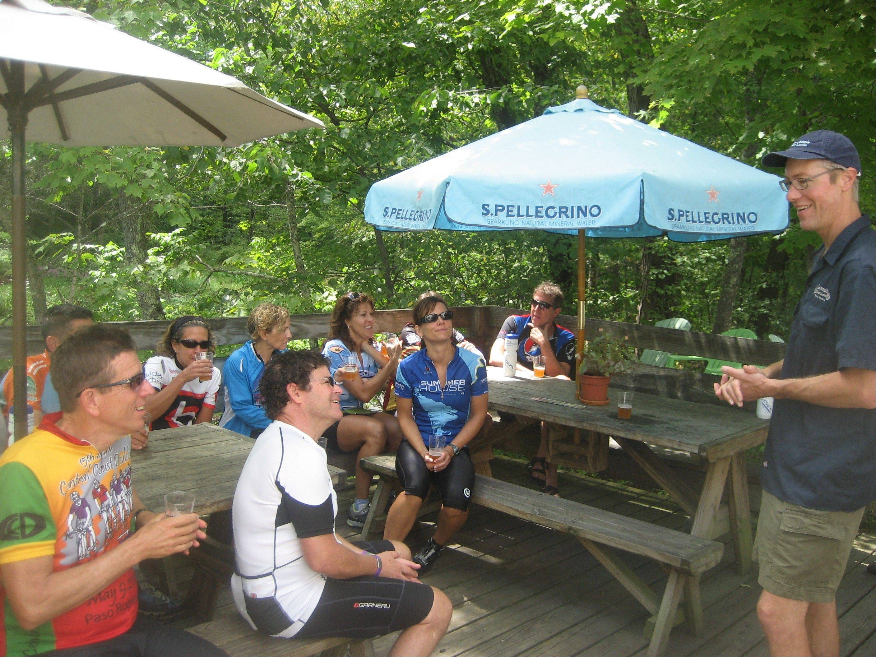 Cyclists take a break during a bike and brew tour in Vermont.