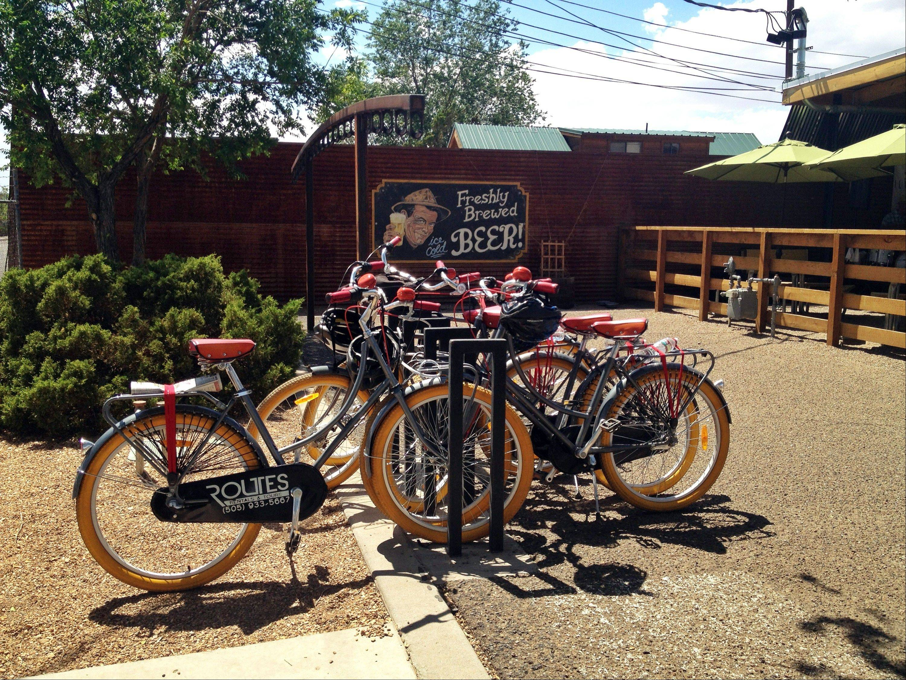 Bikes are parked outside of Il Vicino Canteen in Albuquerque, N.M., while the cyclists go on a brewery tour. Bike tours that take beer-lovers to visit craft breweries are offered around the country.