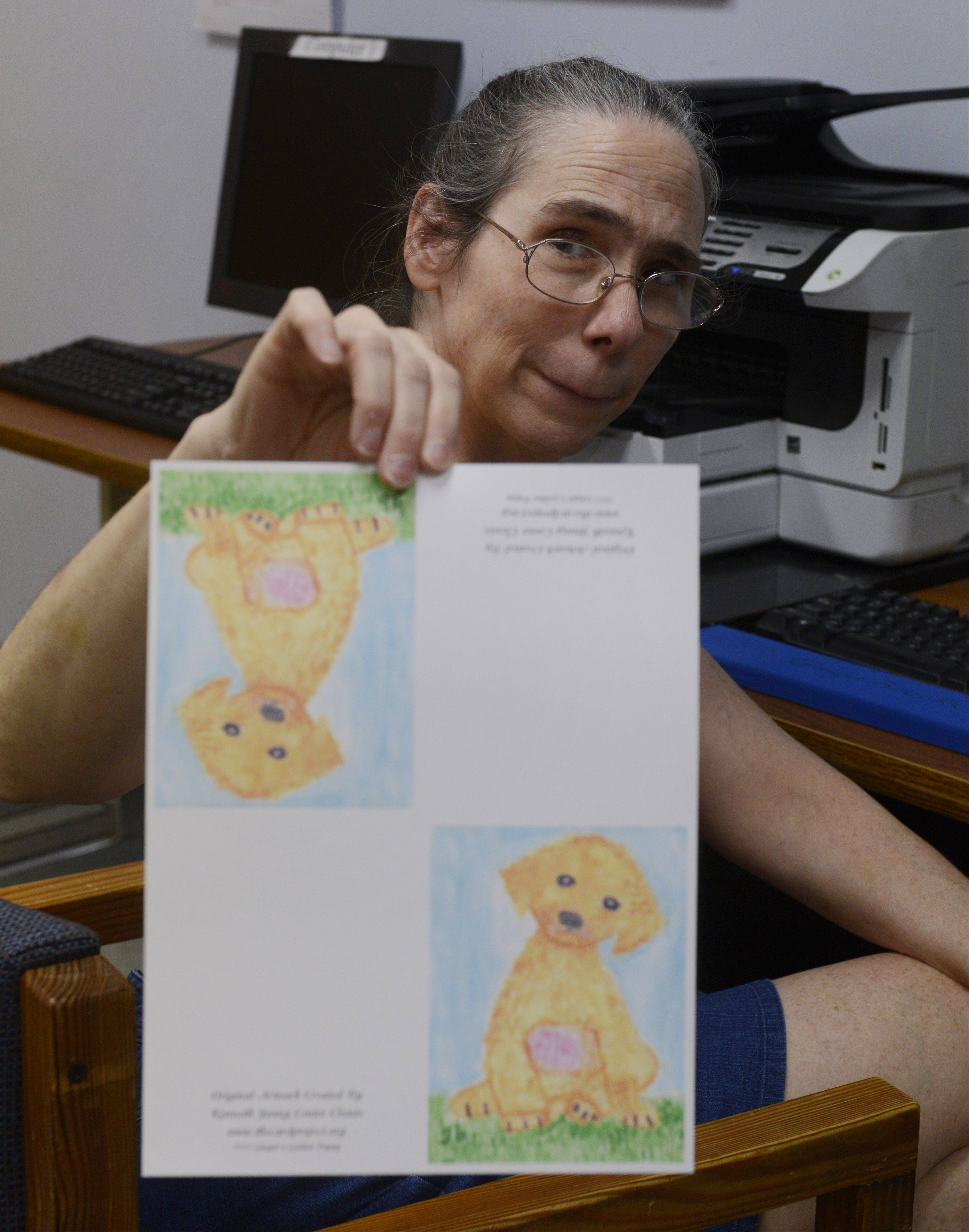 Fresh from the printer, this greeting card sporting a feel-good puppy now needs to be cut and folded, says Michelle Layfield, president of The Card Project at the Kenneth Young Center in Elk Grove Village. Layfield credits the card project for her recovery from mental illness.