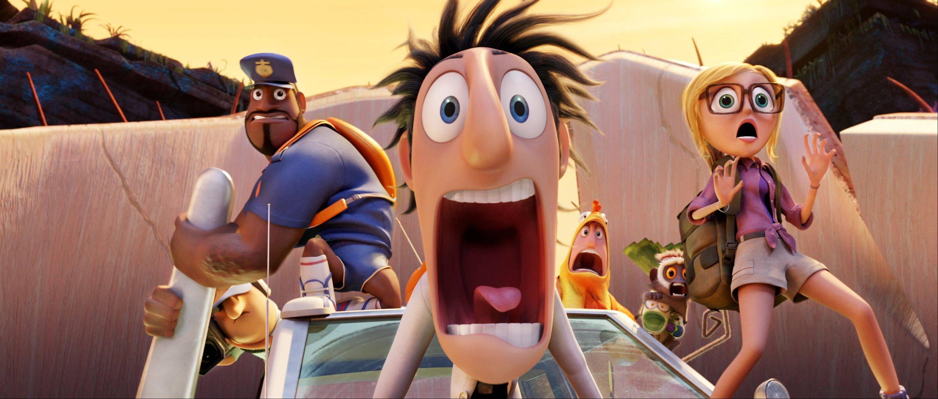 "This film image released by Sony Pictures Animation shows characters, from left, Earl, voiced by Terry Crews, Flint, voiced by Bill Hader, and Sam, voiced by Anna Faris in a scene from ""Cloudy with a Chance of Meatballs."" The animated sequel brought in $35 million in its first weekend of release."