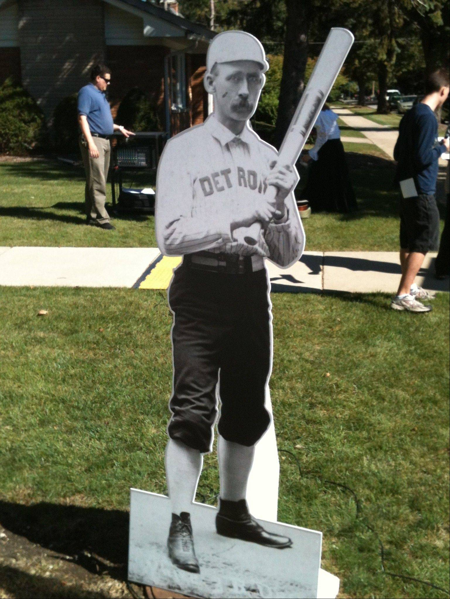 "A cutout of James ""Deacon"" White stood near the corner of Calumet and Marseillaise avenues in Aurora on Sunday. White, who lived much of his life in Aurora, was a 19th century baseball legend who earlier this year was inducted to the Baseball Hall of Fame."