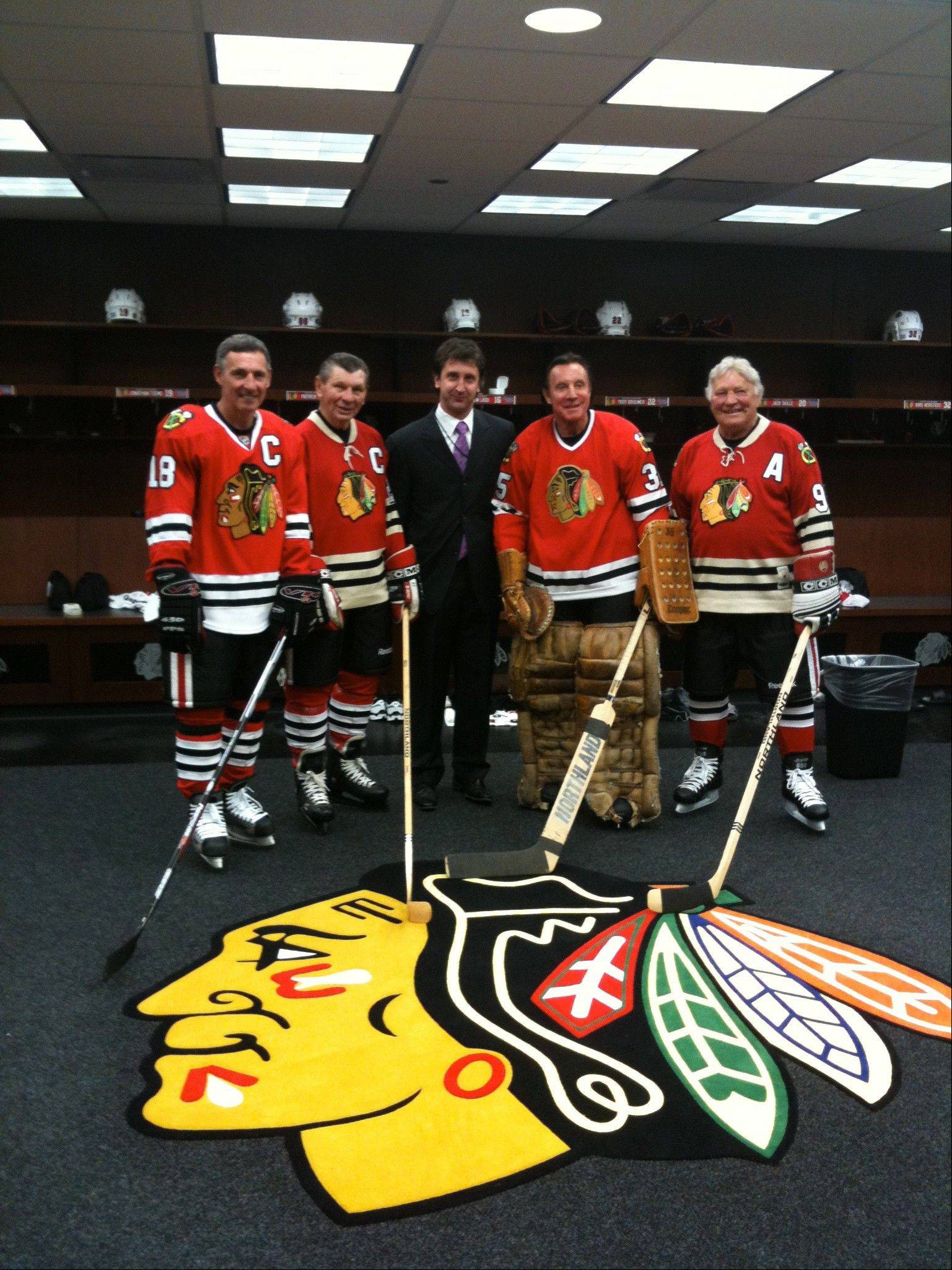 Photo courtesy Michael TerryBlackhawks head doctor Michael Terry with members of the Blackhawks organization in the team locker room at the United Center.