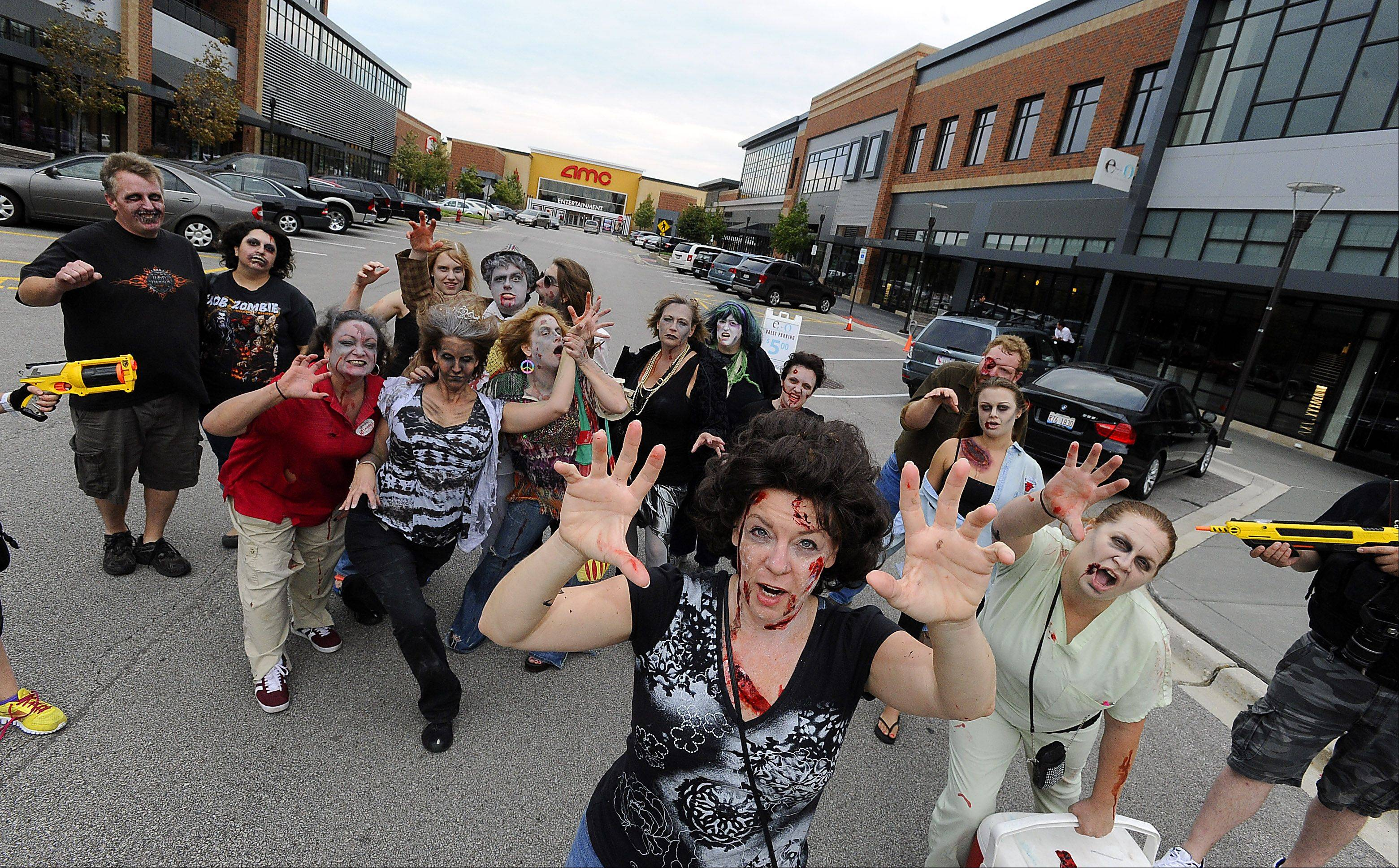 "Teresa Tobin of Mount Prospect, front, and the rest of her zombie friends invaded Randhurst Village in Mount Prospect on Saturday for the annual Save the Brains Zombie Crawl to fight ALS. "" I think it's awesome -- a great cause, and a great time,"" Tobin said."
