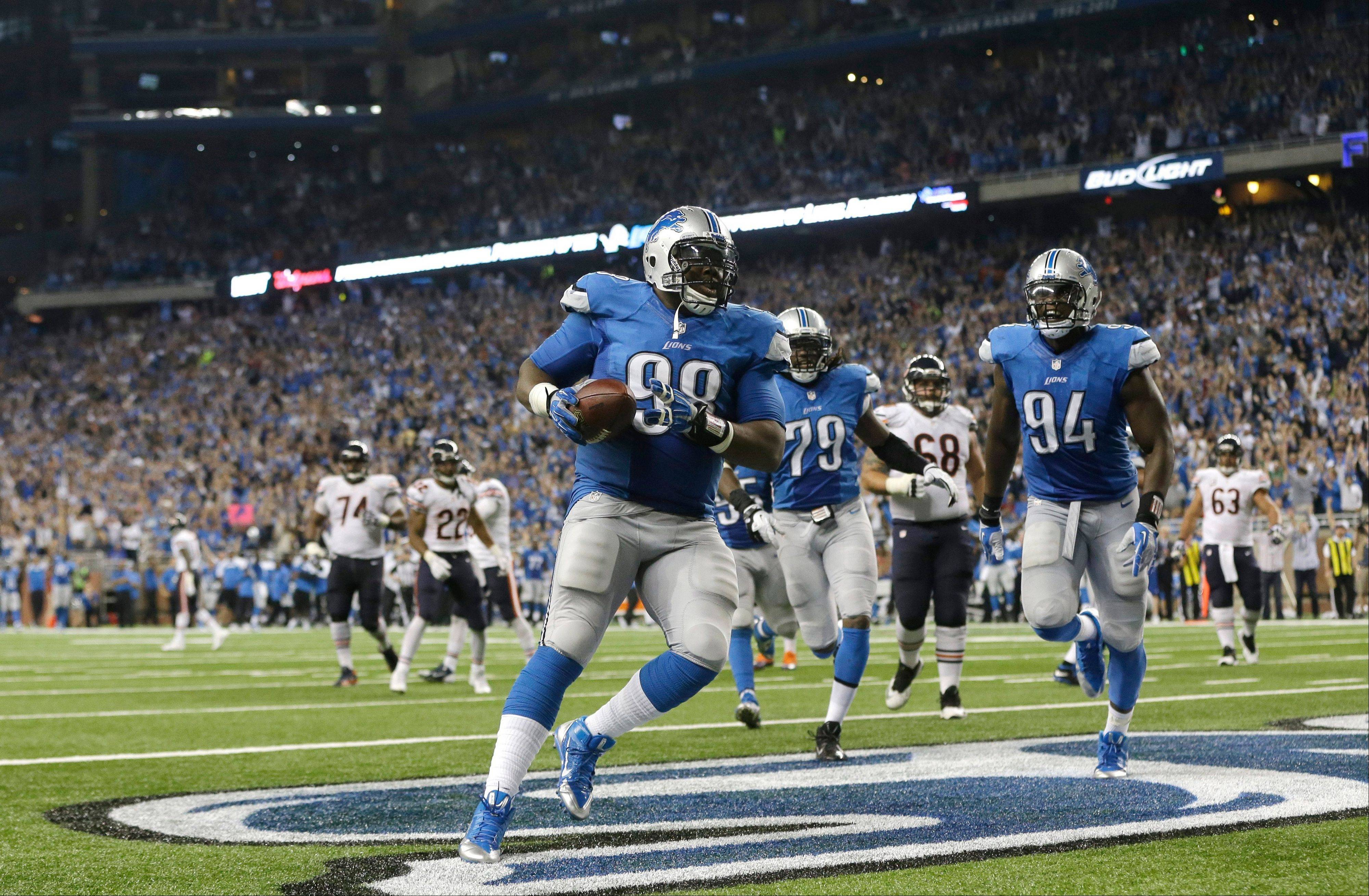 Lions defensive tackle Nick Fairley runs into the end zone after recovering a fumble by Bears quarterback Jay Cutler in the third quarter Sunday at Detroit.