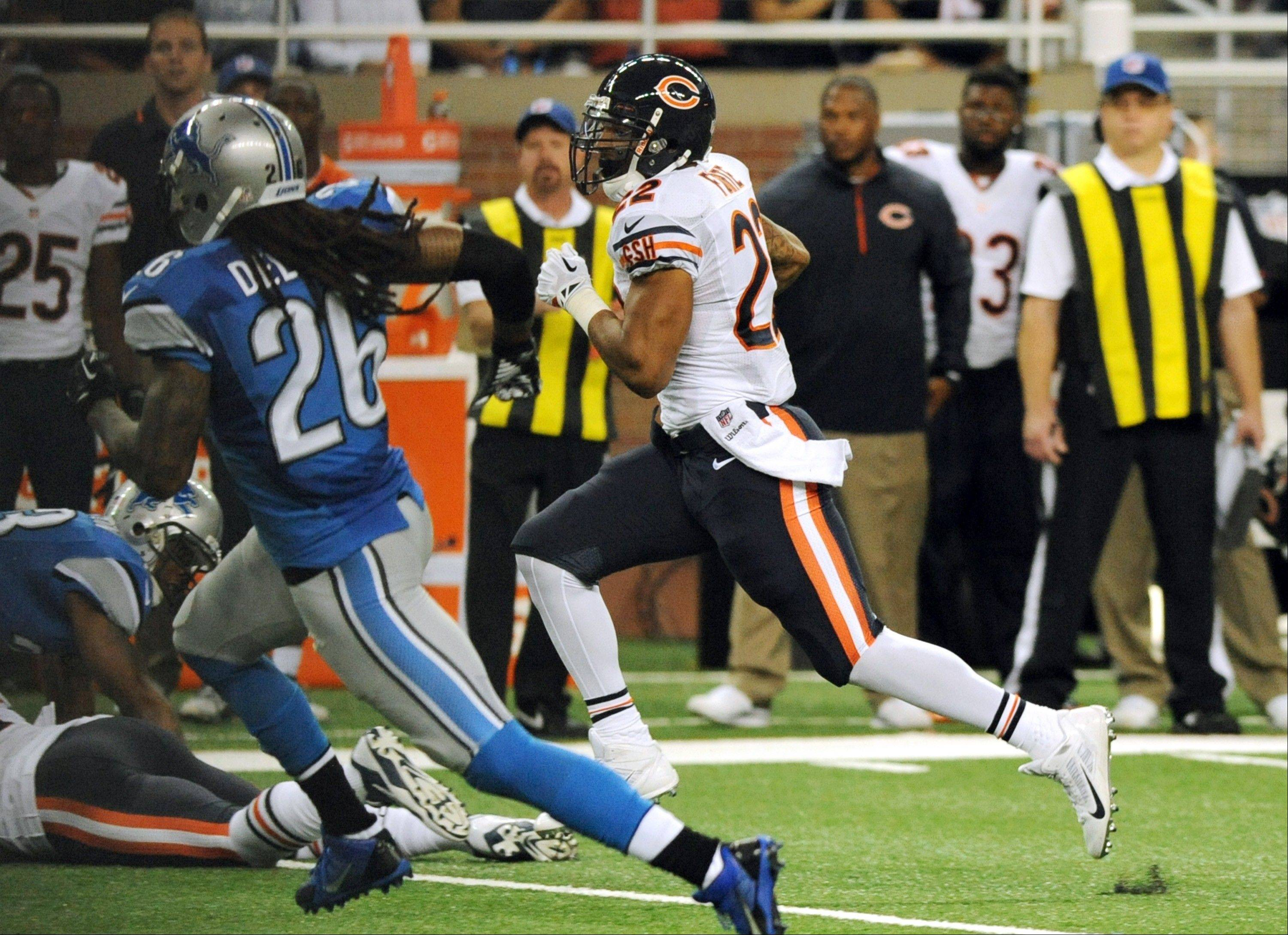 Chicago Bears running back Matt Forte (22) breaks for a 53-yard touchdown during the second quarter of an NFL football game against the Detroit Lions at Ford Field in Detroit.