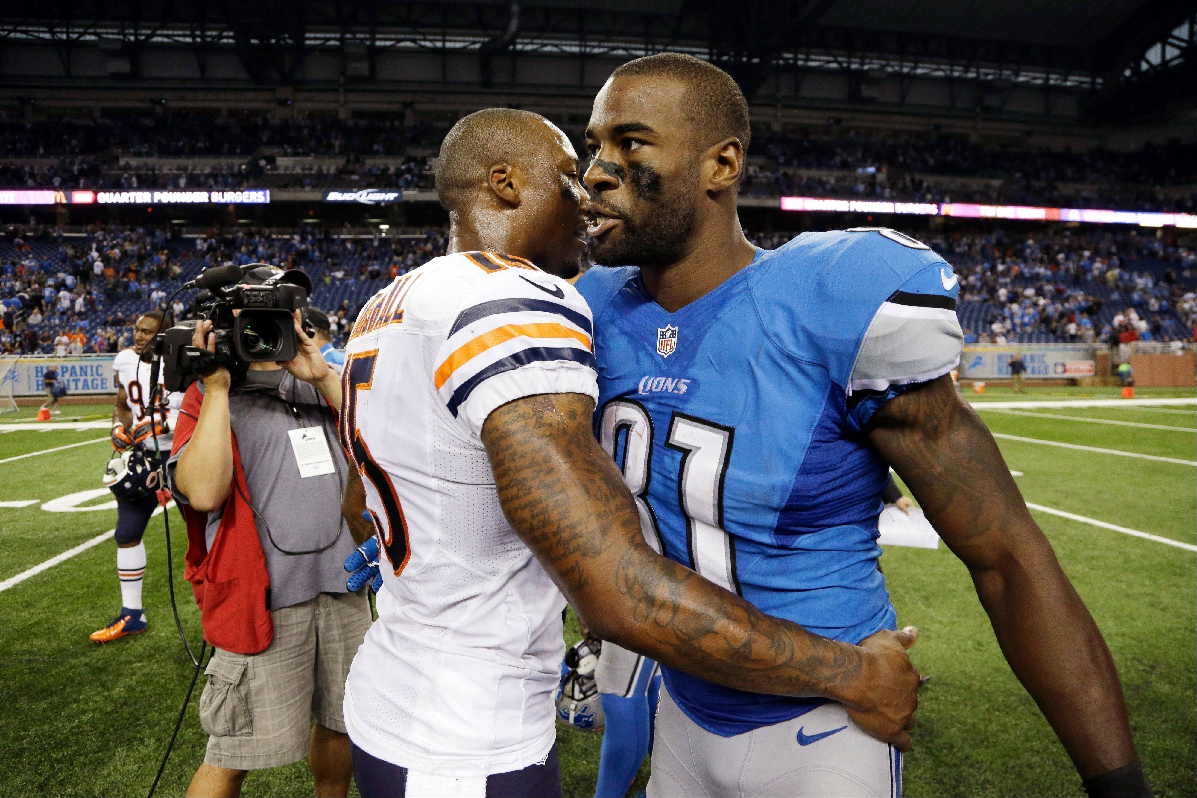 Chicago Bears wide receiver Brandon Marshall, left, meets with Detroit Lions wide receiver Calvin Johnson after an NFL football game at Ford Field in Detroit, Sunday, Sept. 29, 2013.