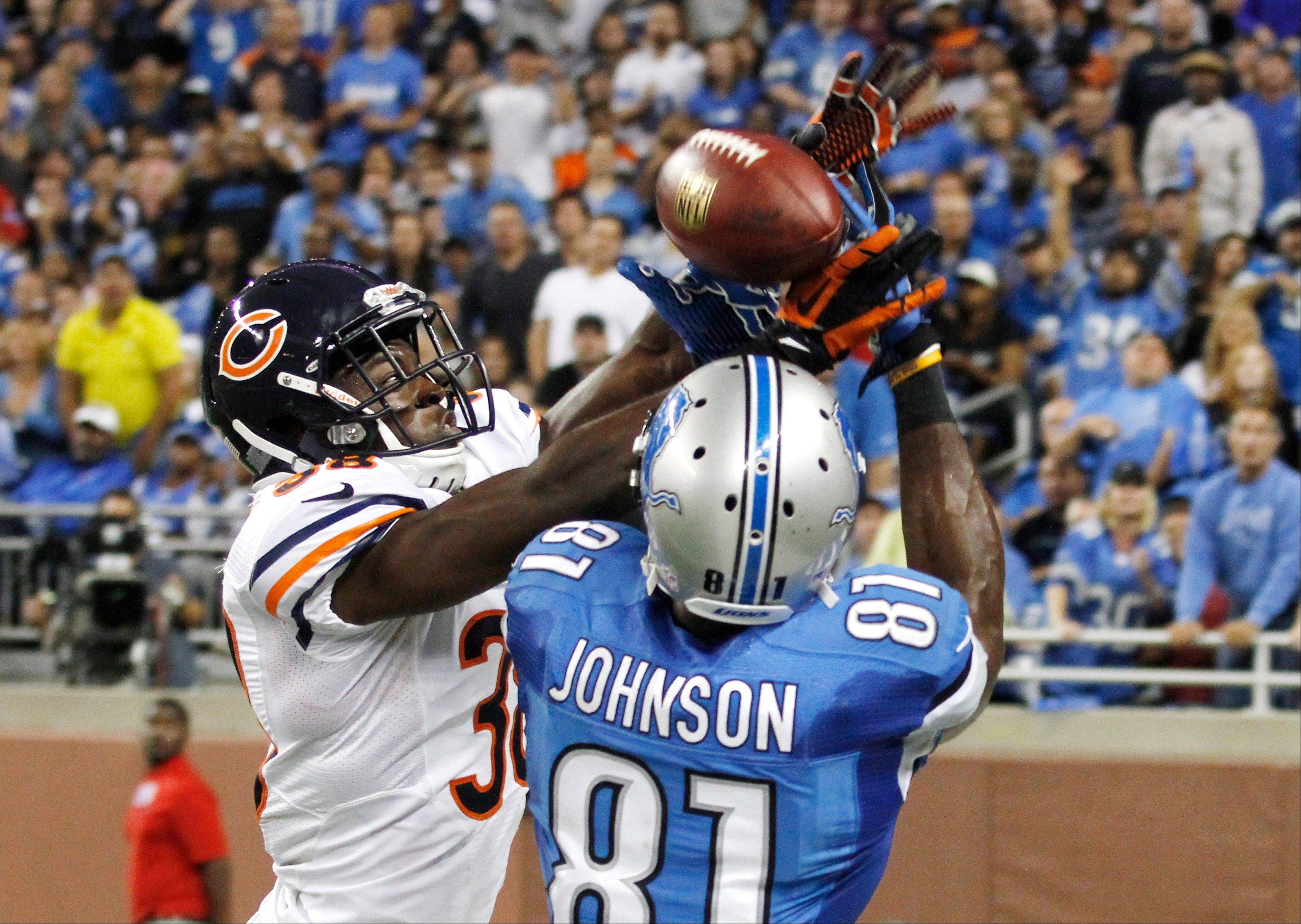 Chicago Bears defensive back Zack Bowman (38) breaks up a pass intended for Detroit Lions wide receiver Calvin Johnson (81) during the fourth quarter.
