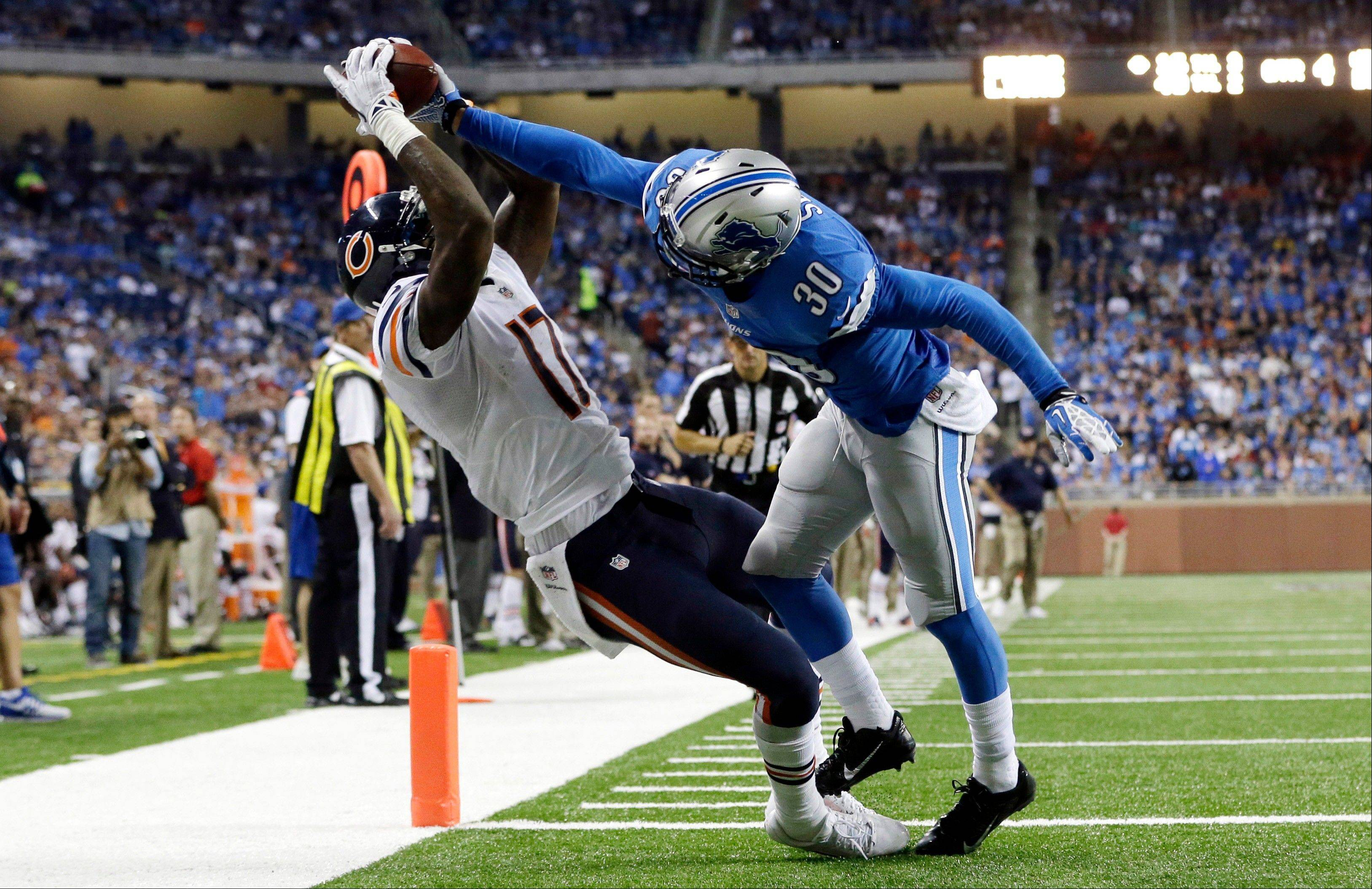 Chicago Bears wide receiver Alshon Jeffery (17), defended by Detroit Lions cornerback Darius Slay (30), scores on a 14-yard reception during the fourth quarter.