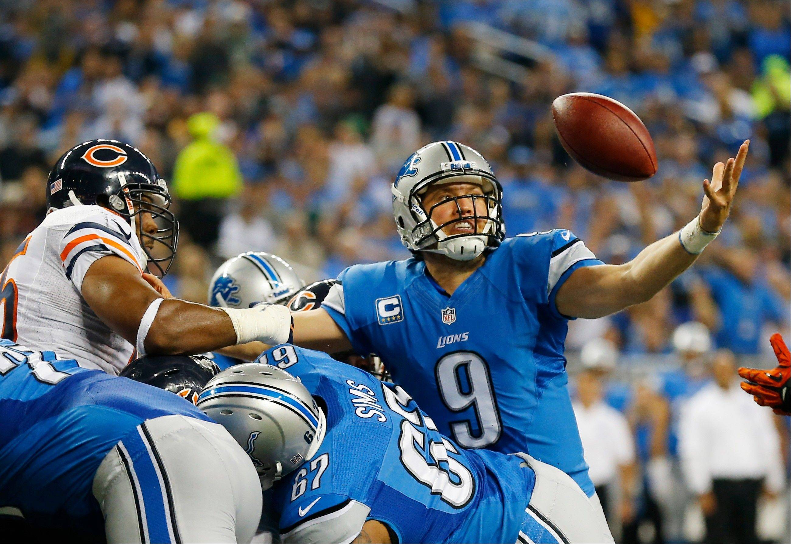 Detroit Lions quarterback Matthew Stafford (9) reaches out to recover his own fumble, and score as he crossed the goal line during the second quarter.