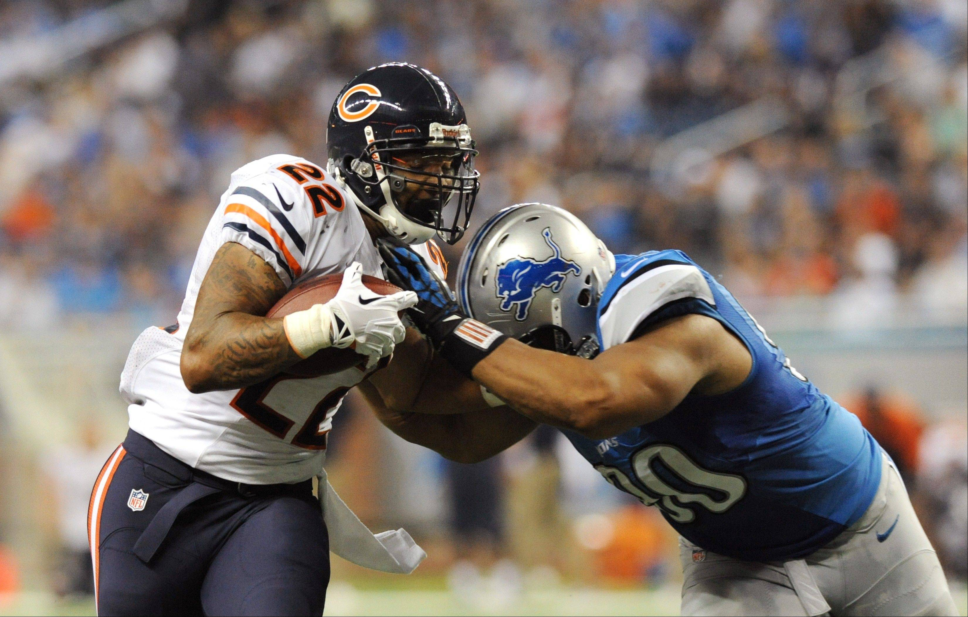 Chicago Bears running back Matt Forte (22) is stopped by Detroit Lions defensive tackle Ndamukong Suh (90) during the third quarter.