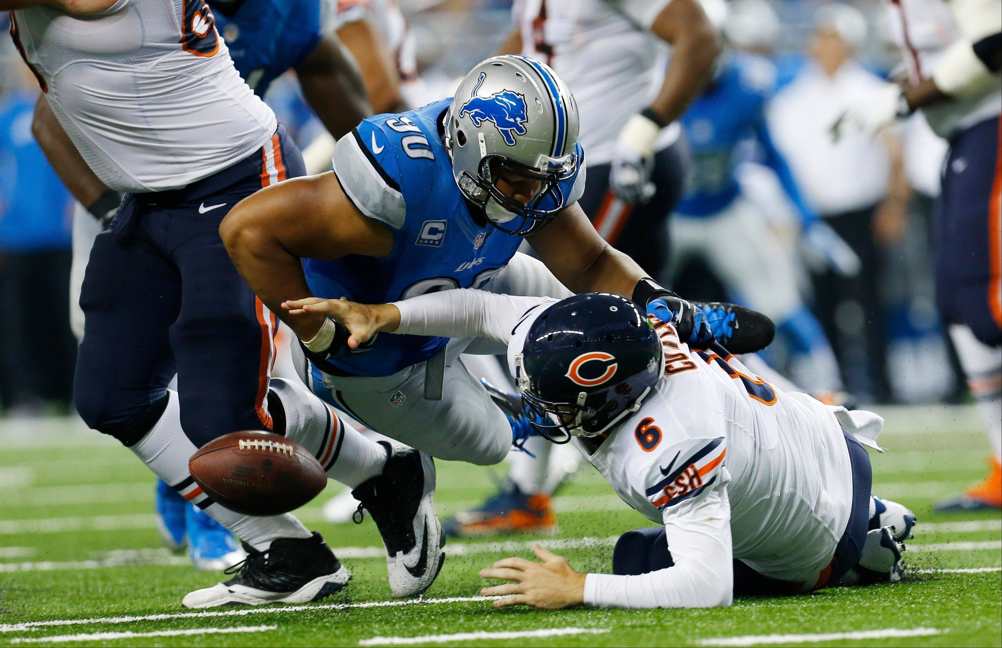 Chicago Bears quarterback Jay Cutler (6) fumbles the ball after a hit from Detroit Lions defensive tackle Ndamukong Suh (90) during the third quarter of an NFL football game against at Ford Field in Detroit, Sunday, Sept. 29, 2013. The fumble was recovered by Detroit Lions defensive tackle Nick Fairley for a 4-yard touchdown.