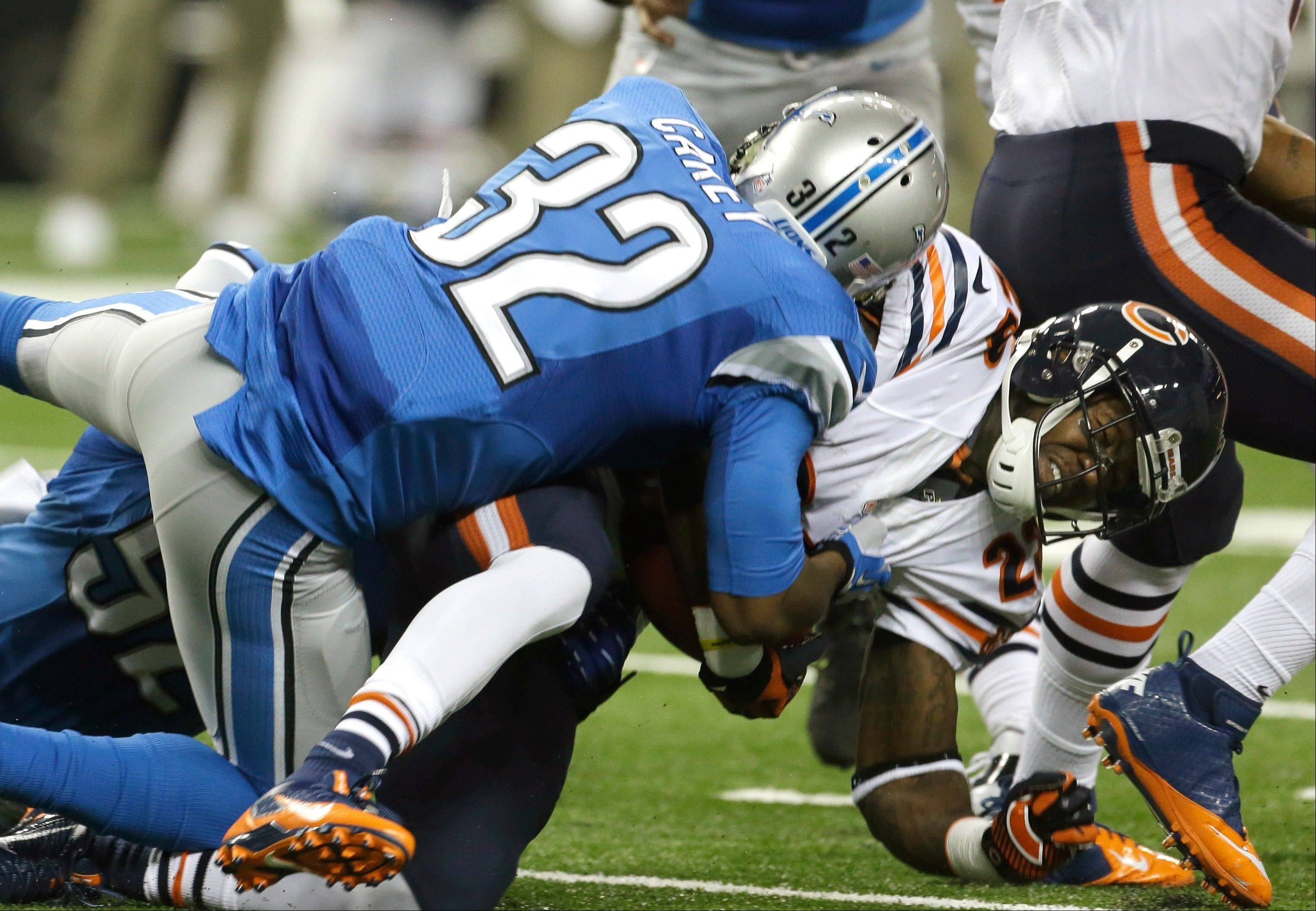 Chicago Bears running back Matt Forte (22) is stopped by Detroit Lions strong safety Don Carey (32) during the first quarter.