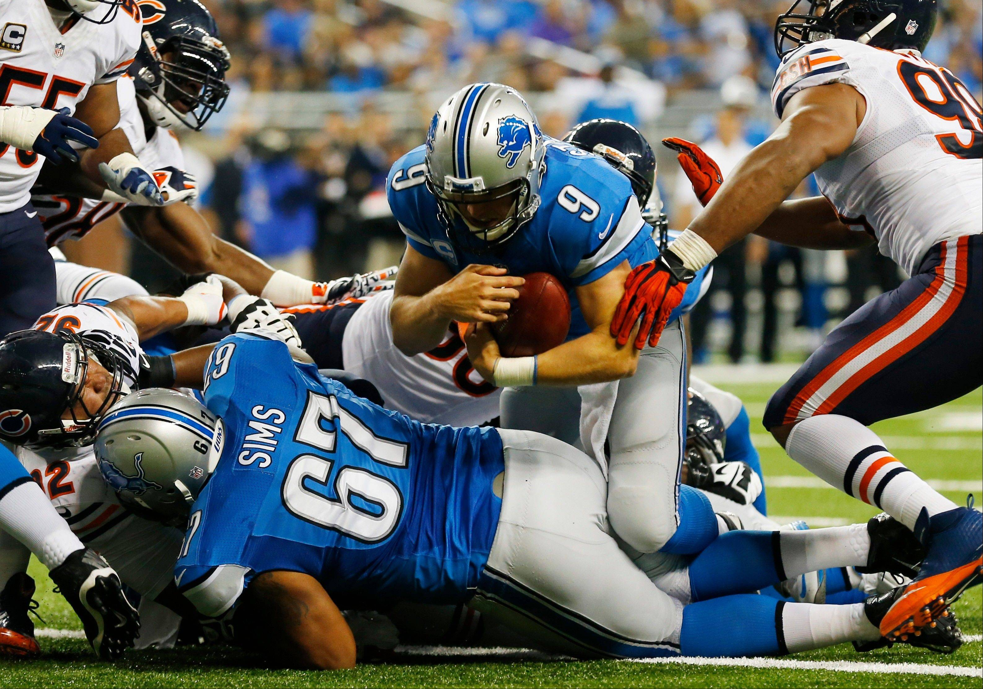 Detroit Lions quarterback Matthew Stafford (9) falls over the goal line for a touchdown after recovering his own fumble during the second quarter.