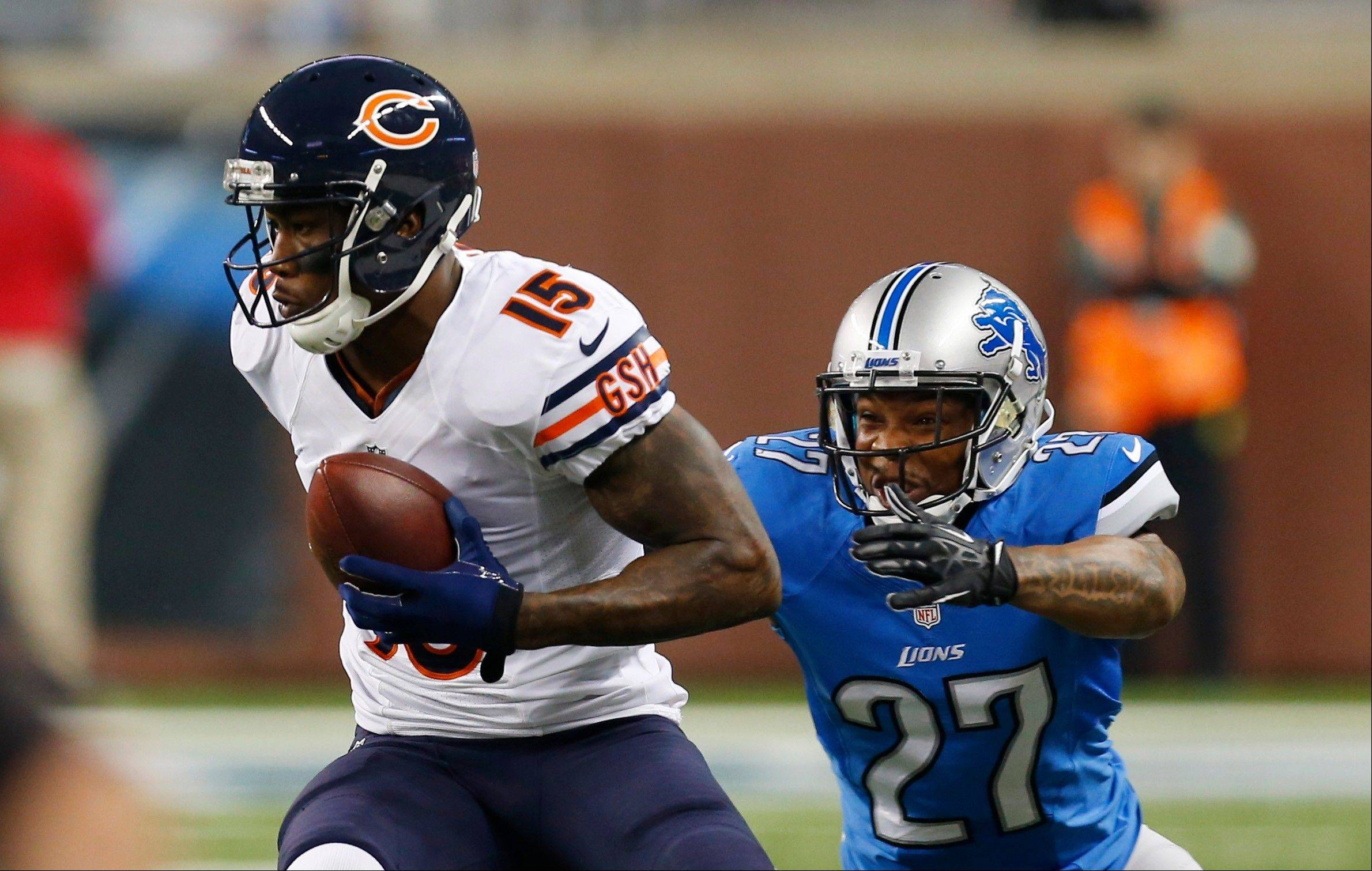 Chicago Bears wide receiver Brandon Marshall (15) pulls away from Detroit Lions strong safety Glover Quin (27) during the first quarter.