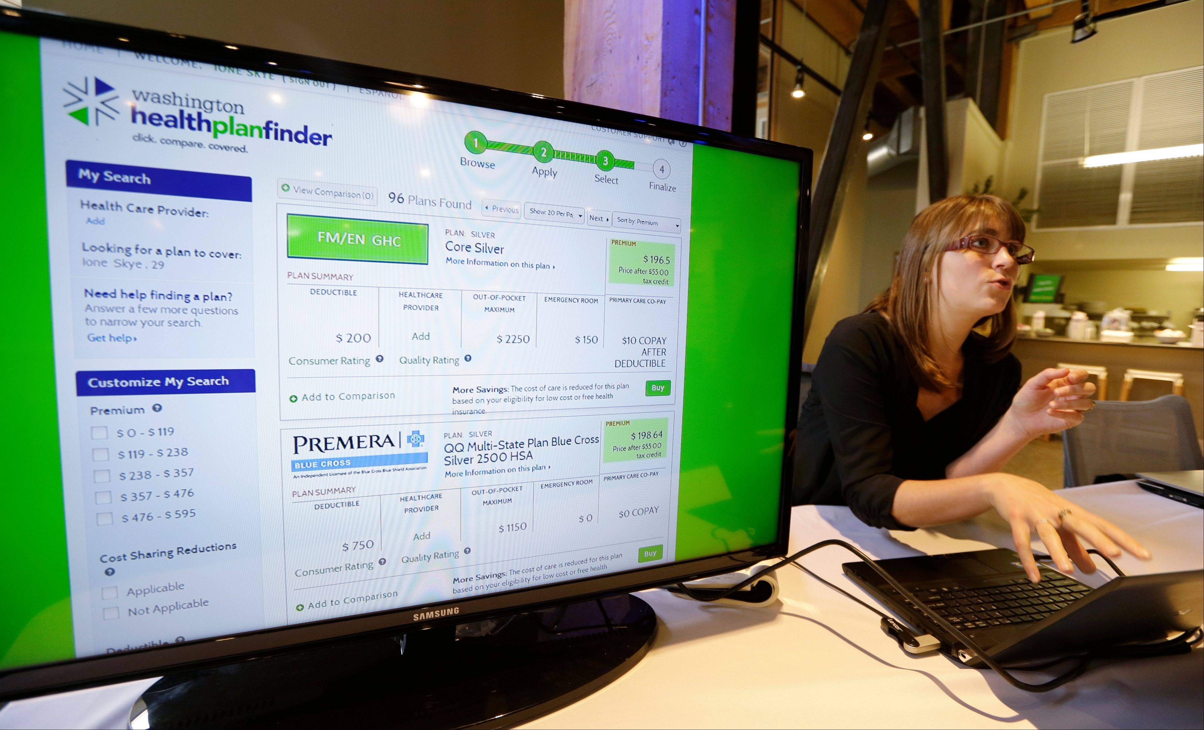 Nelly Kinsella demonstrates the Washington Healthplanfinder website, where consumers will be able to shop for health insurance, following a news conference Monday in Seattle. The new site, which allows consumers to compare and purchase health insurance plans and to see if they are eligible for government subsidies, is Washington state�s online answer to the Affordable Care Act, which is available to the public beginning Tuesday.