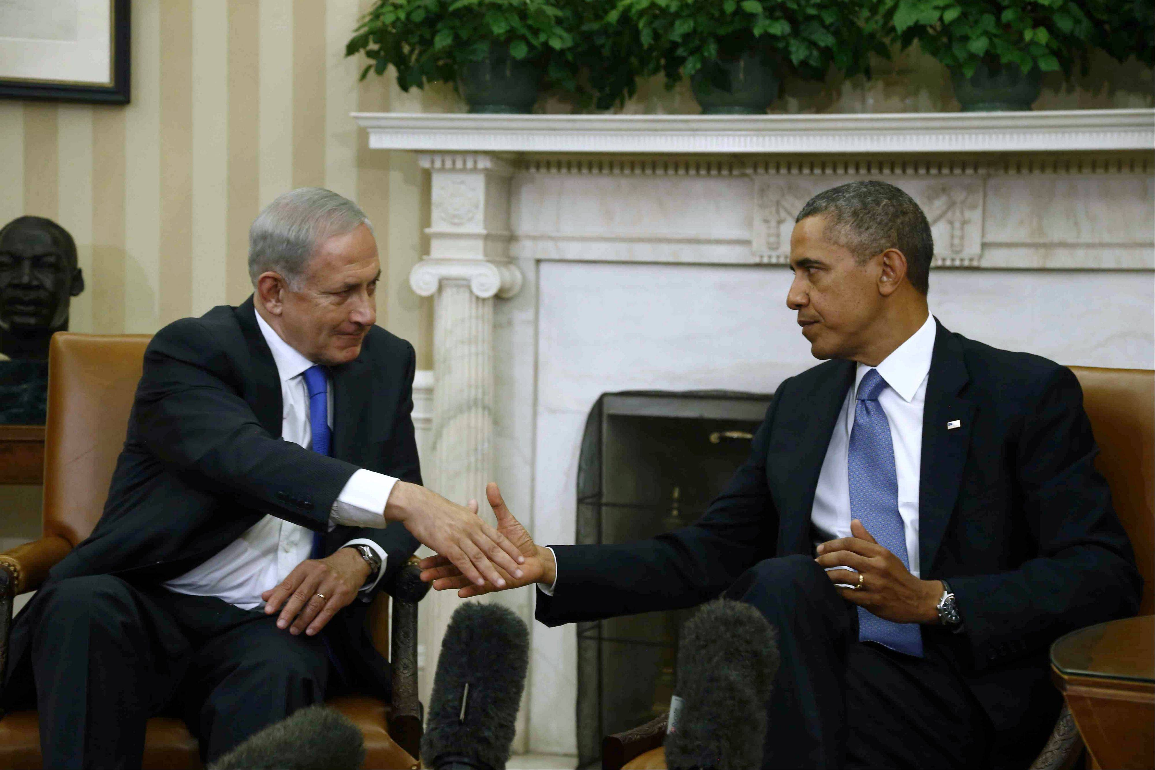 President Barack Obama shakes hands with Israeli Prime Minister Benjamin Netanyahu during their meeting in the Oval Office of the White House in Washington, Monday.