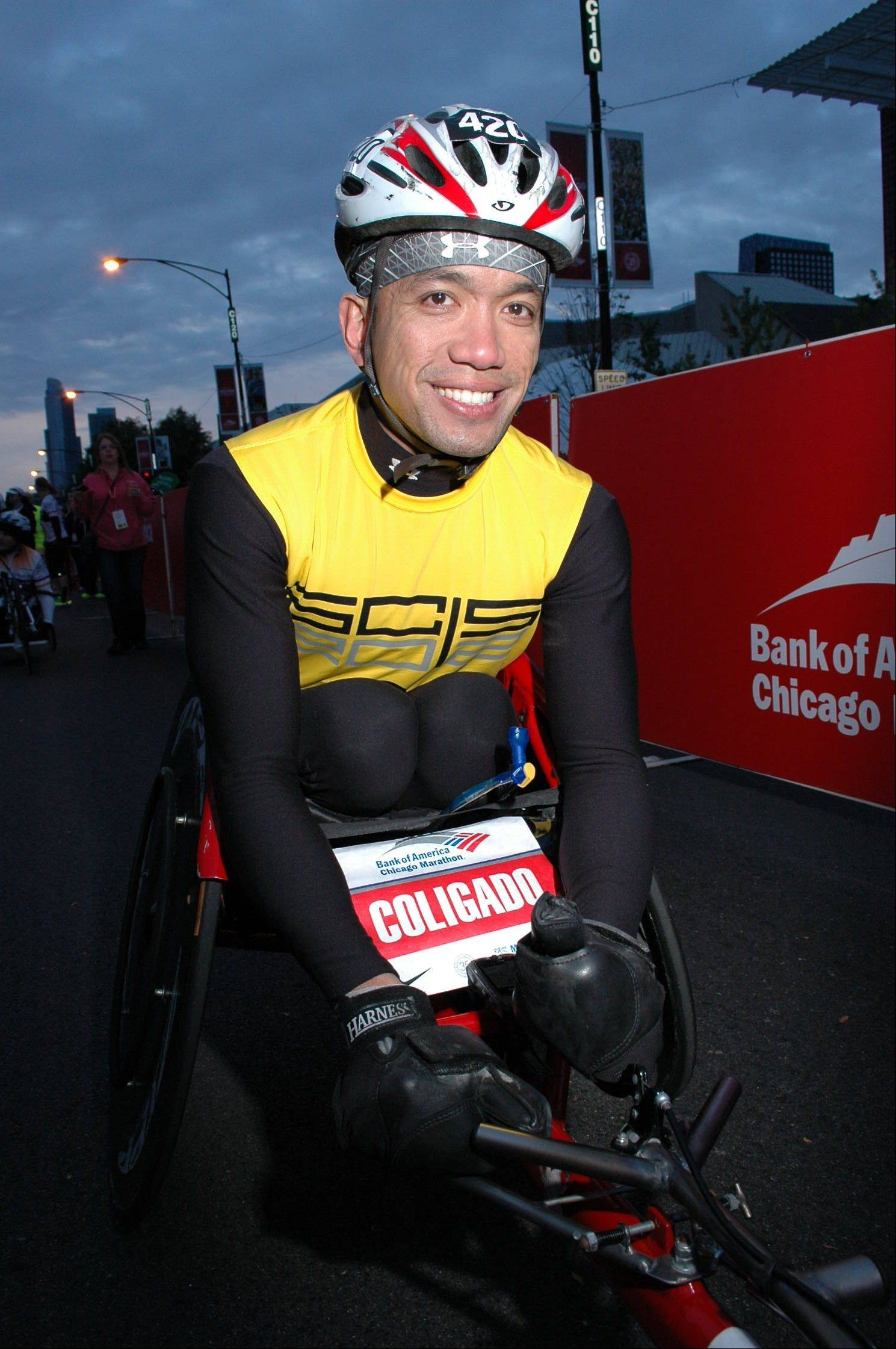 Darwin Coligado of Elk Grove Village participates in wheeled races. He�s racing in his fourth Chicago Marathon Oct. 13.